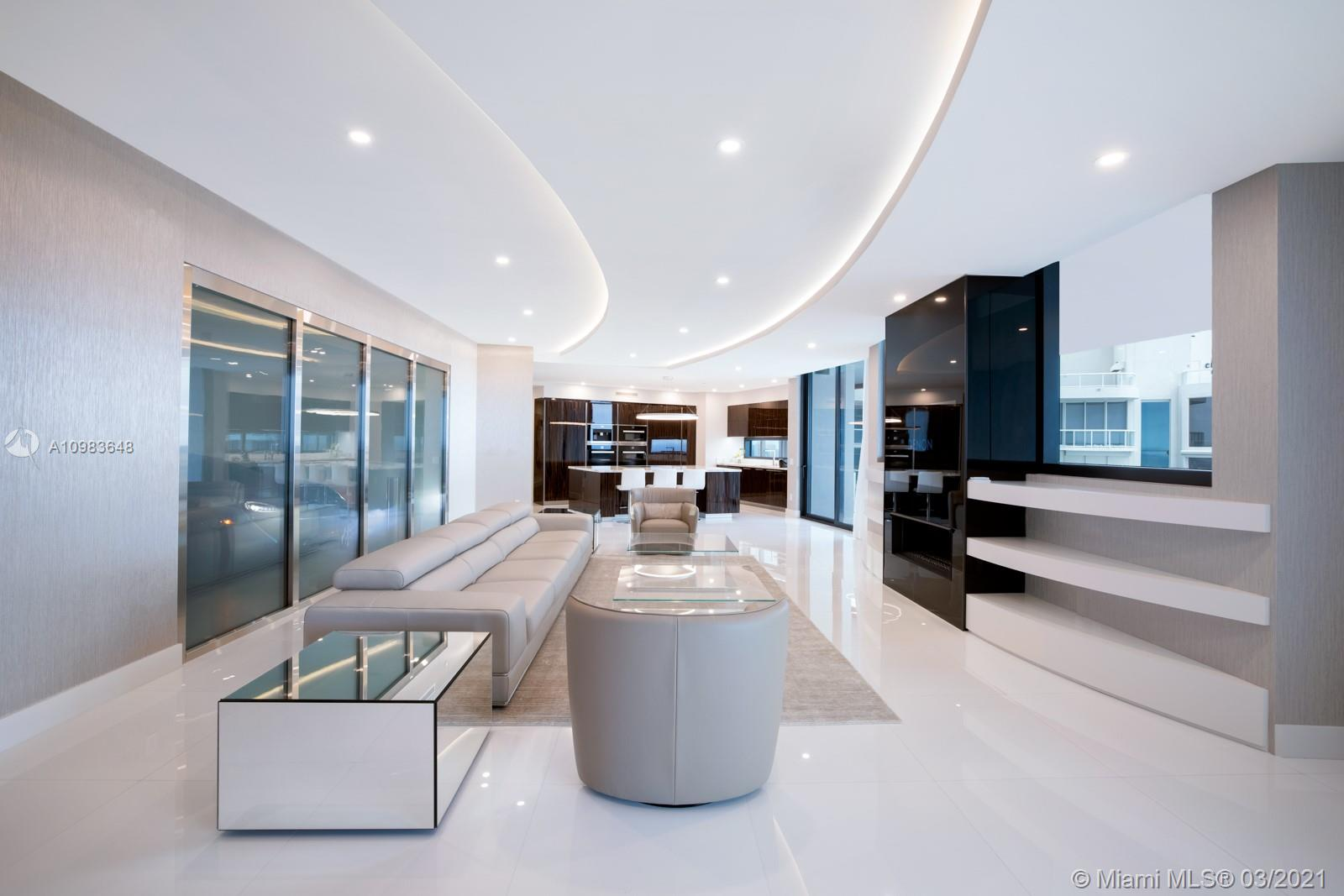 Experience a lifestyle like never before where you can drive into your apartment with your car and have your two cars showcased in your living room. This spacious residence features 3 large bedrooms with jacuzzi on balcony, walk in closets, gorgeous city, intracoastal, sunset, and twilight views. It is impeccably customized and finished by Rockstar Interiors complete with Savant home automation system and built in finger print door. Includes Miele appliances, private elevator, private restaurant with in room dining, building concierge, car concierge, full beach service, two pools, spa, car simulator, sports simulator, movie theatre, salon, bar and party room. Enjoy 5 star resort-like living in one of the most technologically advanced, exclusive, private, and secure buildings in the world!