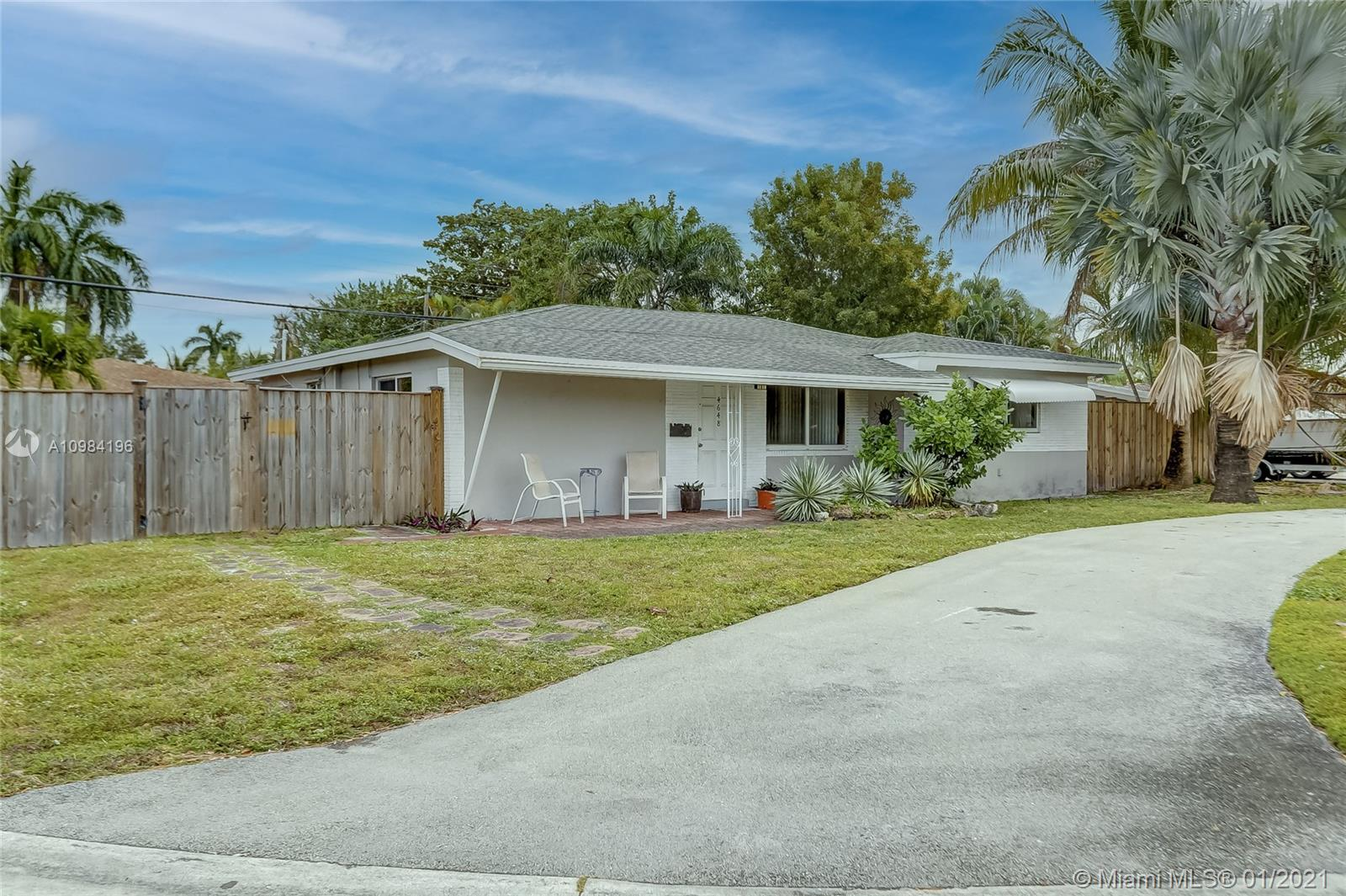 Don't Miss this desirable single family corner lot with NO HOA in North Andrews Gardens. Bring your large family to this 4 bedroom/ 3 bath (garage converted with closet), great open space, huge fenced yard with room for pets and a pool. Great location South of Commercial and East of Andrews, near I-95 and just a few miles to Lauderdale By the Sea. A/C 2020, impact windows except 2 windows in back of house, roof 2013, inside laundry. Tenant occupied, Appt necessary.
