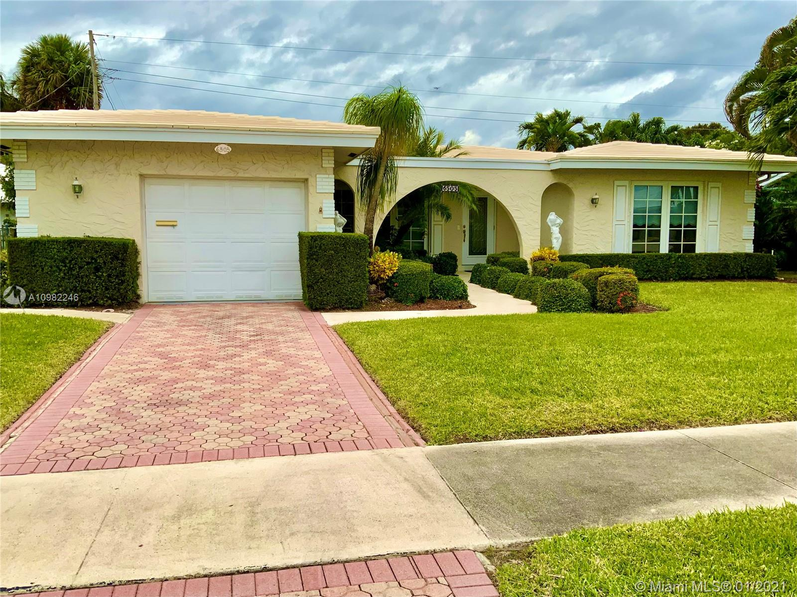 Beautifully and very well maintained home in IMPERIAL POINT! All IMPACT WINDOWS & DOORS. New AC. Nice patio and room for a pool.