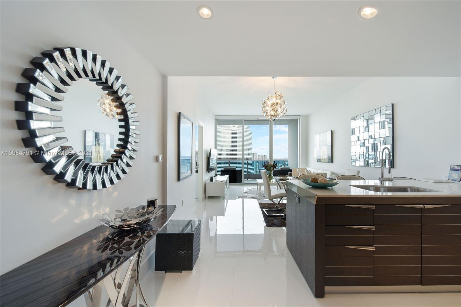 Enjoy The Privilege To Be A Resident At The Luxury Epic Condominium. This beautifully done 1 Bed / 1.5 Bath with Spectacular Views Of The City & River. Building Includes Top Of The Line Amenities. Three Pools, Sauna, Jacuzzi, State-Of-The Art Exercise Room, Restaurant. Close To Aa Arena & Bayside. Parking, Basic Cable and High Speed Internet included.