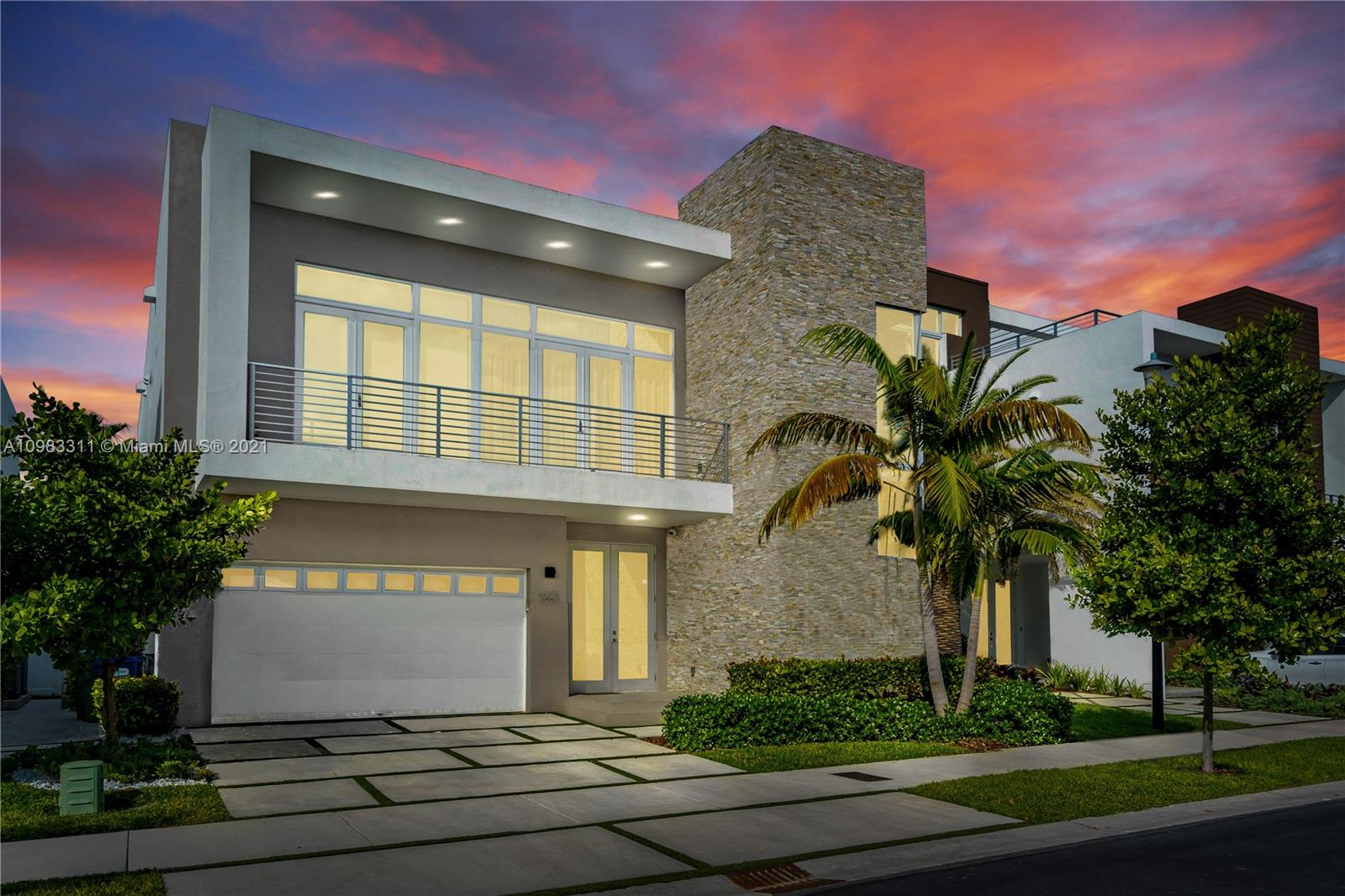The mansions at doral is a gated enclave of 66 ultra-luxurious modern homes that brings the best residential experience for you and your family in the city of doral's most prestigious area. This 5-beds 5 ½ bath porcelanato troughout is fully upgraded. Every square foot has been masterfully designed by architects, designers, and craftsmen. Custom european kitchen w/subzero/wolf appliances. Automatic curtains in double height living room and main room, walk in closets in all rooms, with its stunning summer kitchen next to the lake, designer lamp and courtins in double height space living room, laundry room with utility sink and an exquisite synthetic vertical garden wall in the patio. A unique miami luxury residence property, a must see! Also sold with furniture for a negotiable price.