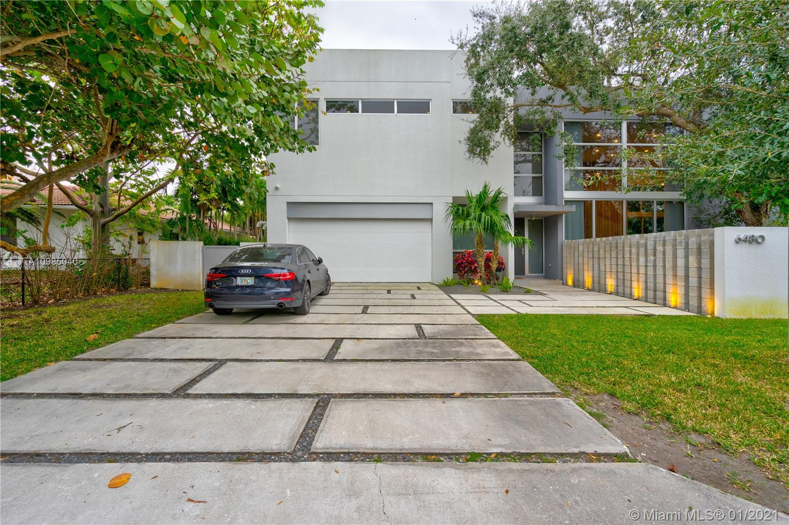 """Designed by acclaimed architect Roney Matey and part of """"The Setting"""" enclave, this luxurious property is found in the very attractive area of South Miami. Tall high pristine glass windows, complete with electronically-controlled curtains, together with a spacious floor plan fill and illuminate this 3 bedroom, 3.5 baths home with natural light. It includes a lavish master bedroom with a magnificent closet, as well as private balconies overlooking a vast backyard complete with an Olympic length pool. Italian-designed Mia Cucina kitchen with quartz countertops adjoining a glass cellar and a beautifully adorned dining room accentuate the beauty of this modern chic home."""