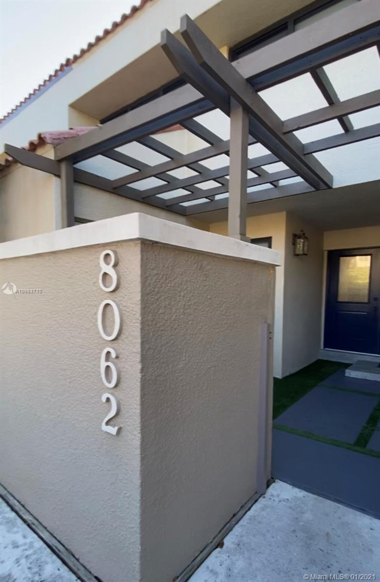 The perfect place for secure, peaceful and convenient living. Completely redone unit with the finest of finishes is ready to move-in. 3/2 with Master bedroom upstairs  and a full room and bath downstairs. Beautiful modern, all wood kitchen opens up to the large living area which Opens up to a lovely patio that fronts a beautiful green area perfect for your pet or children to enjoy. Enjoy the tennis/racquetball courts , gym and pool in a very well maintained community. Near Baptist and South Miami Hospitals. Walk to shopping and dining and just minutes to Dadeland, South Miami, the Grove & Gables and Metro Rail. Park in front of your uni which includes storage space and full laundry. 24/7 manned gate and roaming security.