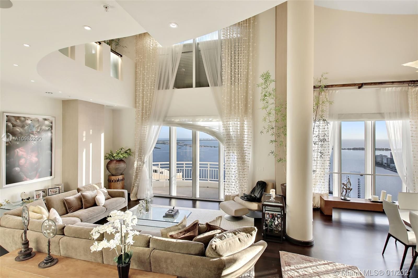 One of a kind!! Gorgeous PH on Brickell Key!  Breathtaking, direct water views from every corner! This very unique property is one of the few with high 40ft ceilings. Wood in all bedrooms, marble in baths/kitchen. This beautiful and spacious PH features 3 beds/3.5 baths, includes a cabana by the pool, a closed private garage within the parking area with room for more than two cars and extra storage. A true gem! Among the building's amenities you will find pool, 2 level fitness center, BBQ area, tennis court & racquetball court, valet, concierge & much more. Best location within the sought after island of Brickell Key, minutes to the best shopping, dining and the best Miami has to offer while in the quiet of Brickell Key