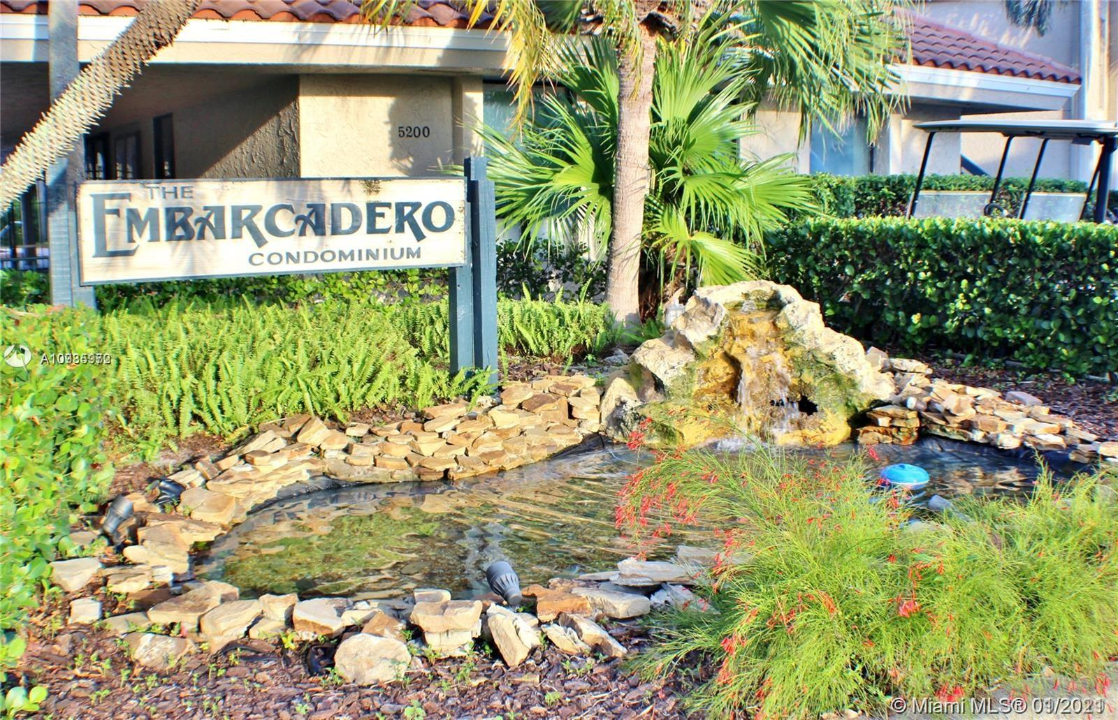 Fantastic 1st Floor unit in the gated community at Emabarcadero condominium. Both the unit and the complex are very well maintained. Unit has a great location in the complex.  Convenient easy access to plenty of shopping and restaurants nearby. Unit features new Dishwasher and all plumbing has been updated. New tankless water heater and Garbage Disposal. Tile floor throughout. Ceiling Fans and a great screened in porch too!! This is a must see .  Shown by appointment.