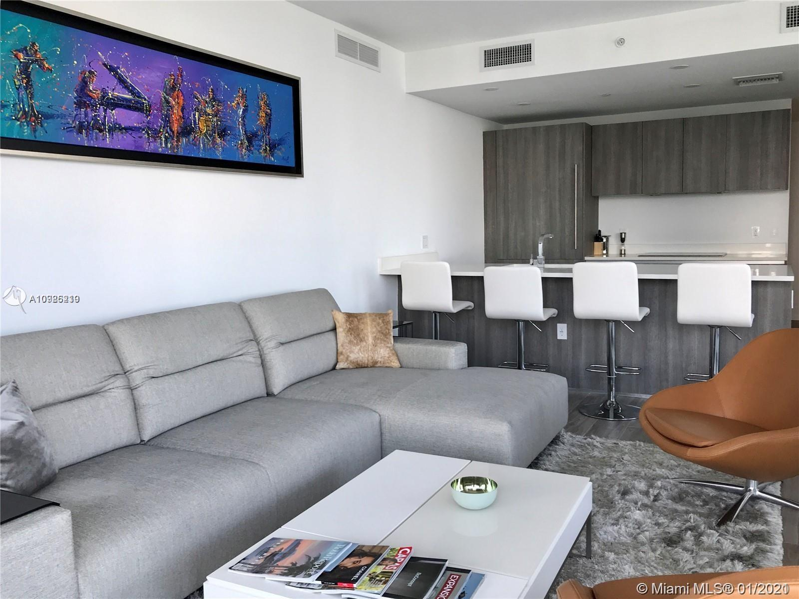 3/3 with 3 self park assigned spaces on a Spectacular corner at the sophisticated SLS LUX! BRAND NEW. Wrap around balcony with sweeping views of Biscayne Bay & Brickell skyline. The unit is fully furnished by Bo Concept, the kitchen upgraded (Sub Zero, Wolf and Bosch appliances ) and the bath upgraded too. Custom built closets and electronic blinds all over the apartment. Three (3) assigned self parking spaces. SLS Lux has the best common areas by world renowned designer Yabu Pushelberg. Amenities include: 2 pools, fitness center, spa/sauna, kids room, game room, rock climbing wall, bbq area, tennis court, basketball court. Serices include 24H concierge, valet and security, plus room service from Katsuya restaurant and much more. Easy to show. Text agent directly.