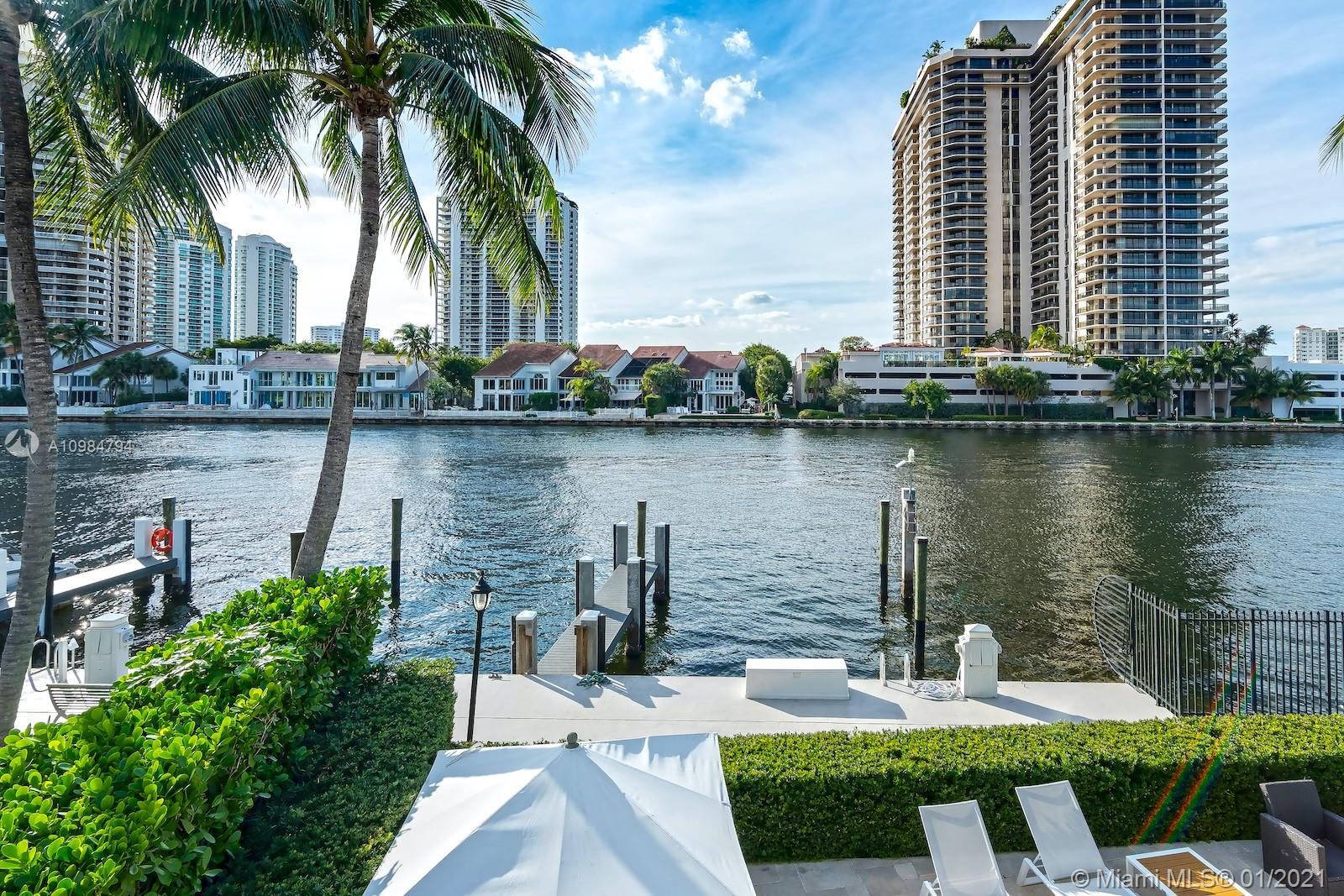 Completely remodeled WATERFRONT PROPERTY with your own dock (can fit up to 72' boats).Magnificent 5 bed-4.5 bath plus a completely staff quarter(1 bed- 1 bath) located in this private gated community. This property is walking distance to the beach, with its own marina , tennis court, and kids playground. Finest finishes include, Marble floors , impact windows, brand new kitchen , lighting , and automatic window treatments. Spectacular 50' waterfront outdoor backyard,  to enjoy family BBQ, pool days and more.