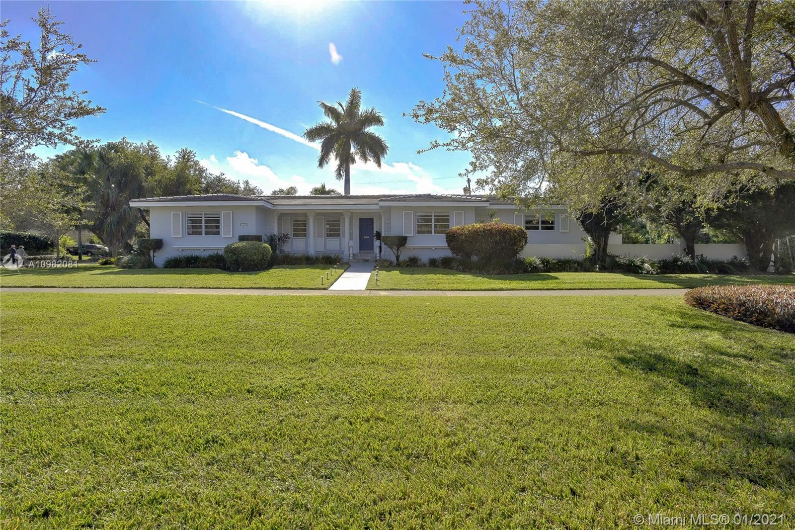Welcome to this beautiful, sun-filled South Gables home sitting on enormous 17,701 sq. ft. corner lot. Walk into gleaming wood floors and impact glass French doors leading out to large deck and garden. 2020 flat tile roof, large living/dining area with windows all around, oversized family room. Remodeled, bright eat-in kitchen, large pantry, indoor laundry area. Extra-large bedrooms with built-in/walk-in closets. Ring doorbell/security cameras throughout, beautiful outdoor lighting, large outdoor terrace. Fully functional 2 car garage, generous private side guest parking. Professional renderings from renowned architect for 6,000 sq. ft. new construction estate available upon request. Endless possibilities! Enjoy side-walked lined street and play in huge garden at this South Gables home.
