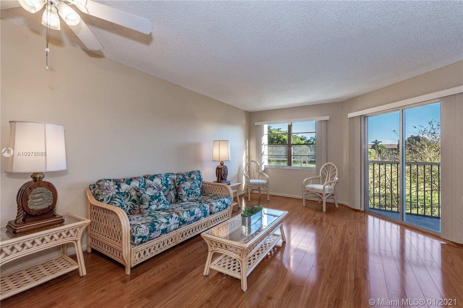 Beautiful and bright condo located in the heart of Pembroke Pines. Walk into this beautiful 1 bed 1 bath unit with an amazing view to enjoy your coffee in the mornings. Spacious kitchen to prepare delicious meals and with plenty of cabinet space. Beautiful and shiny wood floors throughout. Completely modern and renovated bathroom. Washer and dryer conveniently located inside the unit; assigned parking & plenty of guest parking for family and friends. The property is move-in ready. Century Village is one of Pembroke Pines' most desirable active adult communities. Enjoy resort-style living, with endless amenities: million-dollar clubhouse. The community is located next to the shop of Pembroke Gardens and major highways. Schedule a showing now! Don't miss this opportunity!
