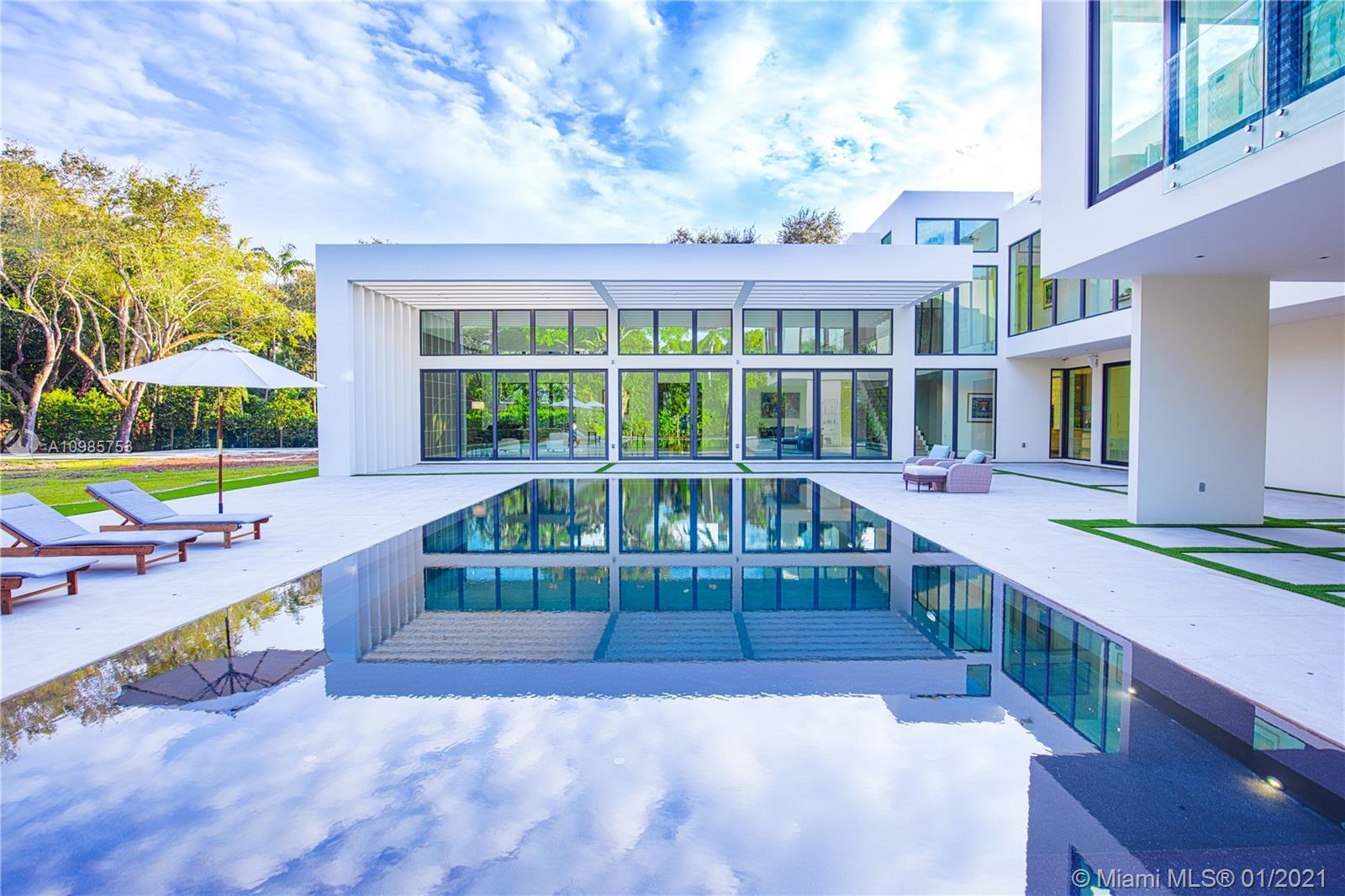 Stunning modern architectural masterpiece designed by Kobi Karp on rare 1.44 acres in Ponce Davis. Built in 2014, this 10,000 SF gated estate blends open concept interiors with sweeping landscape to provide spaces for grand entertaining and intimate family relaxation. You are welcomed into a magnificent great room with soaring 16-foot ceilings and a wall of glass opening on to the breathtaking negative-edge heated pool/expansive terrace. The home features 7 bedrooms including a sumptuous 1,500 SF master suite, 7.5 baths, Mia Cucina kitchen with SubZero/Wolf/Miele appliances, 264-bottle wine cooler, guest house, rooftop terrace, squash court/gym, home theatre, 3-car garage, Lutron/Sonos/URC smart home systems, whole-home generator. An extraordinary achievement of sophistication and privacy.