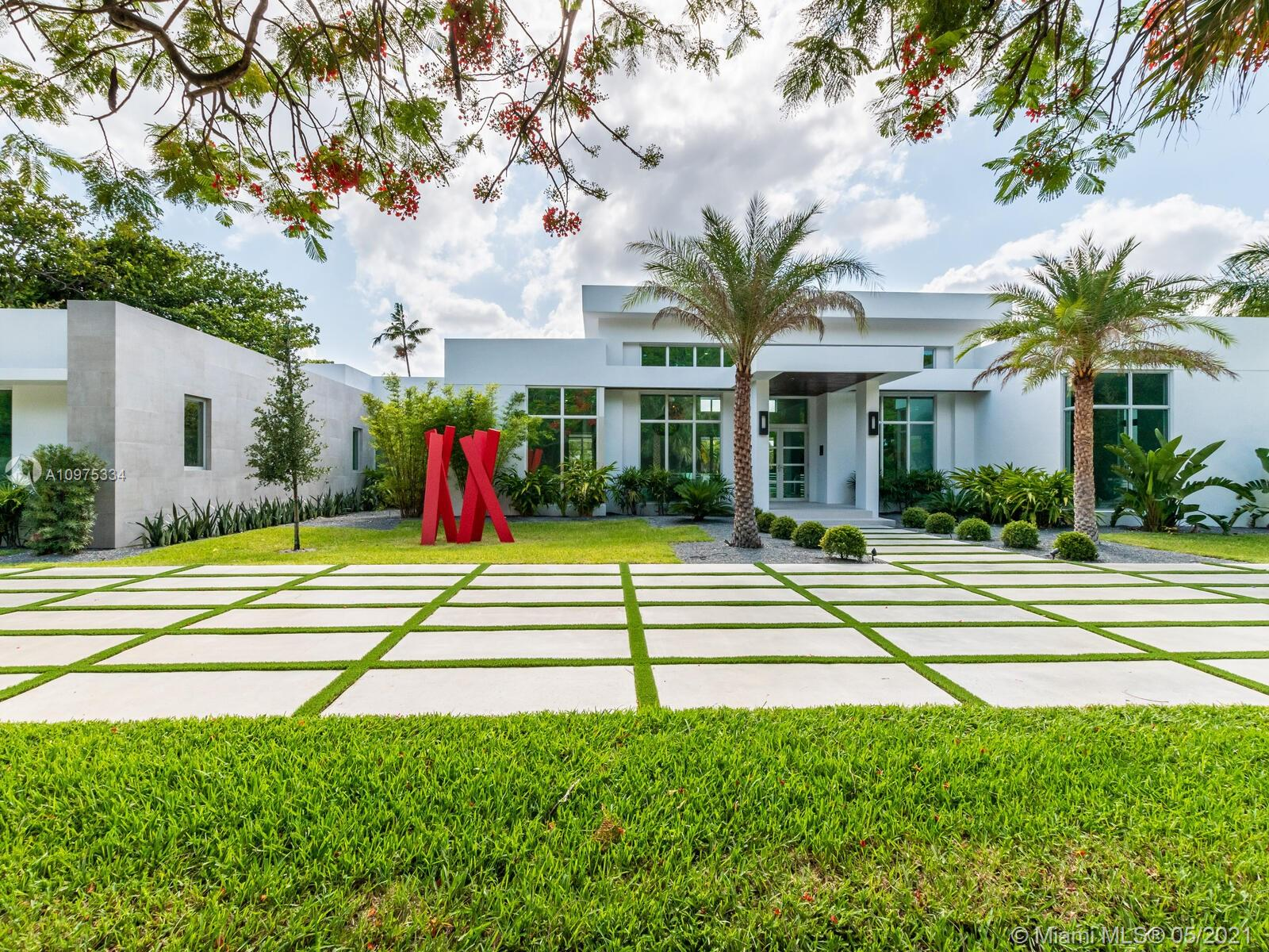 A BAUHAUS INSPIRED ONE-ACRE LOT, BY RENOWNED ARCHITECT MARK REARDON. SURROUNDED BY THE ELEGANT CORAL GABLES AND PINECREST AREA. OUR 7,700 SF RESIDENCE OFFERS SIX BEDROOMS PLUS A MEDIA ROOM AND SEVEN BATHROOMS, EUROPEAN FLOORS INCLUDING A MAGNIFICENT POWDER ROOM & CABANA BATH WITH VANITIES MADE IN ITALY BY LAGUNA. THE KITCHEN HAS AN IMPRESSIVE AND MODERN LAYOUT WITH ITALIAN CABINETRY BY VENETA CUCINE, WOLF & SUBZERO APPLIANCES, BREAKFAST AREA, WINE CELLAR AND A BAR. THE LIVING ROOM HAS A GORGEOUS VIEW OF THE INFINITY POOL WITH SALT SYSTEM, JACUZZI AND A STUNNING TERRACE FOR A SUMMER KITCHEN.