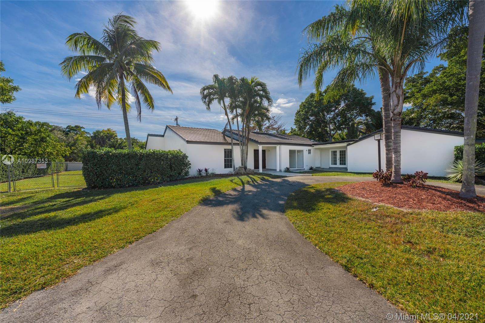 Cut your commute time with this centrally located pool home located in one of Miami's most desirable areas. Set within a quiet cul-de-sac, this spacious home features a new contemporary, flat-tile roof, an updated kitchen with stainless steel appliances, quartz countertops, and a unique layout including a privately-set room ideal for a home office, plus in-law quarters with a dedicated entrance. Vaulted ceilings in the living room and master bedroom add character to this bright and freshly painted home, offering pool views from various spaces including the expansive family room/kitchen. Walk-in closets, a pool terrace, plus room to park a boat/trailer on a sprawling lot are a plus! Located near great schools, restaurants and shopping. Masks required during showings.