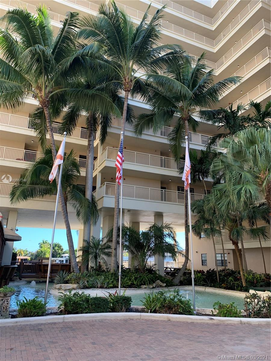 Location, Location, Location. Ground floor apartment on the canal. Sit outside on your 36-foot deck and watch the boats traversing the Intracoastal. Walk from your private deck onto your boat, docking available. Spacious split 2-bedroom floor plan with ensuite bathrooms and a half bath off the entry. All rooms open onto the outside deck. Impact sliding glass doors. Updated kitchen, A/C and water heater, stainless steel appliances. Washer/dryer in the unit. One covered parking space. All furniture and household accessories included in the price except for some personal items. Closing date cannot be before May 31, 2021.
