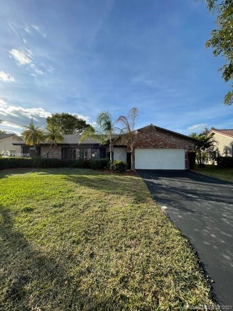 4/2 BATH 2 CAR GARAGE. POOL ALL  NEW TILE FLOOR  REMOVE KITCHEN AND BATHROOM  ENCLOSED POOL WITH WATERFRONT VIEW. NICE PATIO  FORMAL DINING ROOM SPLIT PLANVIEW TO POOL & CANAL