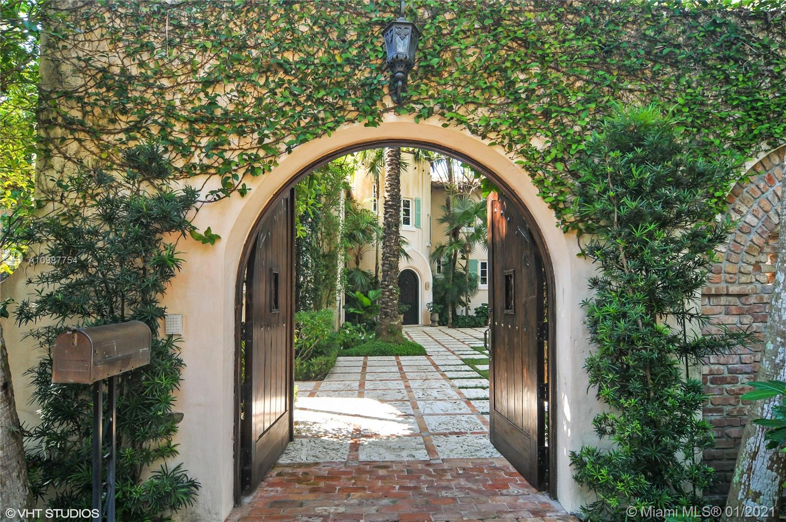 Designed by Walter DeGarmo, one of Miami's most historically significant architects, circa 1929, restored, maintained and updated to the highest standards of the 21st century, this residence of classic lines sits in one of Coconut Grove's finest in-town, gated addresses. This Mediterranean revival villa, on over ¾ acre, is a treasure of Coconut Grove. The charming foyer and formal living room with open wood beam ceilings, wood burning fireplace and stone mantelpiece, look out to gorgeous grounds and sparkling Biscayne Bay beyond. Also, there is a formal dining room , formal breakfast room, three family bedrooms with en-suite baths, plus a stunning, lavishly scaled master bedroom suite. Add a kitchen to delight, staff bedrm & bath, 2 car garage, and 1 bedrm guest house. To see is to buy!