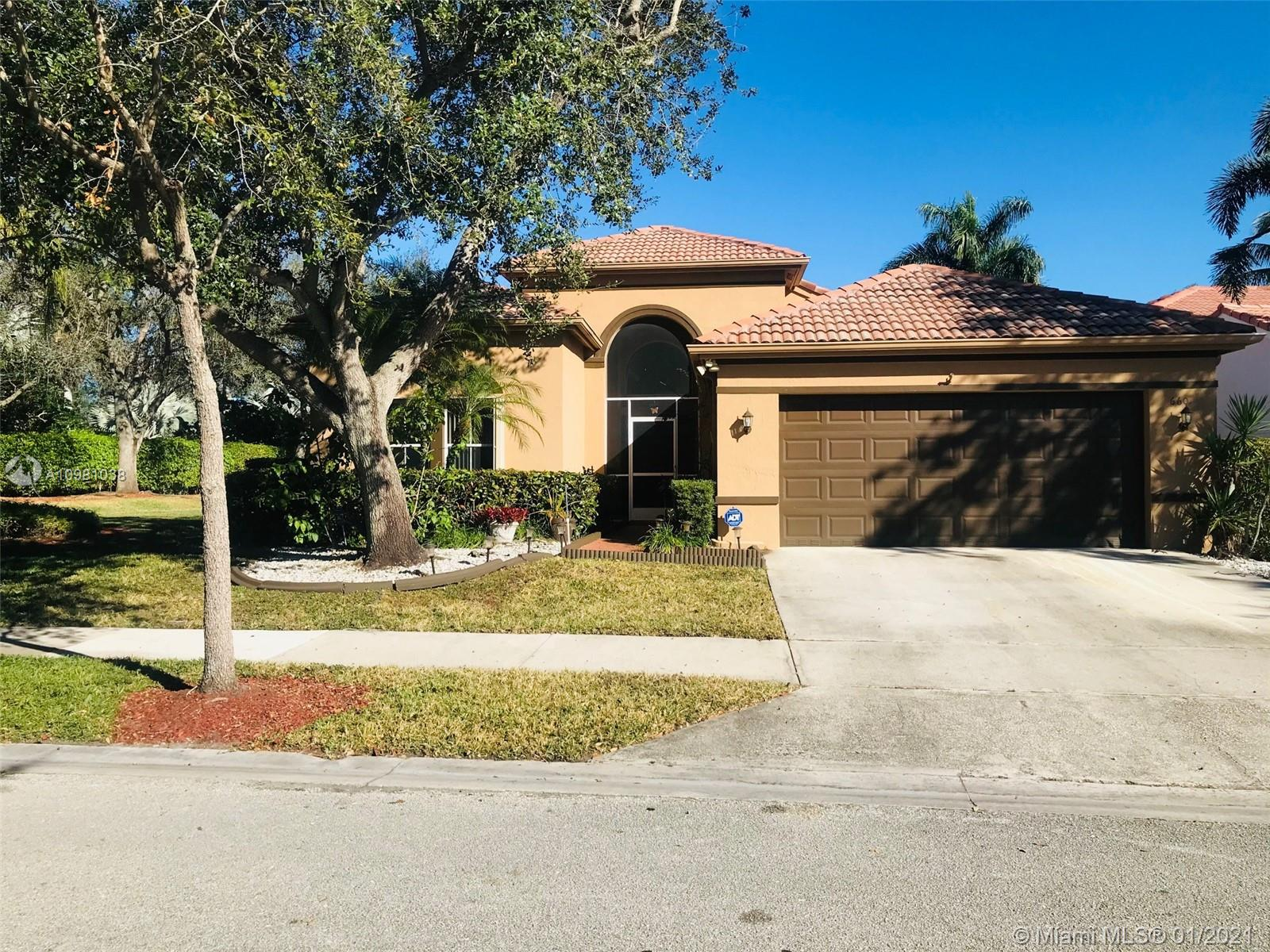 "Excellent Location!! Beautiful home located on a huge corner lot of 8243 sqft, desirable 24/7 guard gate Community of North Lakes in Weston, with all ""A"" graded schools. Amazing one story floor plan, 3 bedrooms 2 1/2 bathrooms. Foyer entry, impact front entry doors. Formal Dining and Living room with high ceiling. Nice and cozy kitchen with overlooking pool area, upgraded quartz countertop, spacious family room. Spacious master bedroom with overlooking pool area, bathroom with double sinks, shower and bathtub, his and hers closets. Neutral ceramic tile in social areas and baths, laminate in family room and carpet in bedrooms. Accordian shutters and hurricane garage door. Covered patio and screened heated pool is ready for your enjoyment and entertainment."
