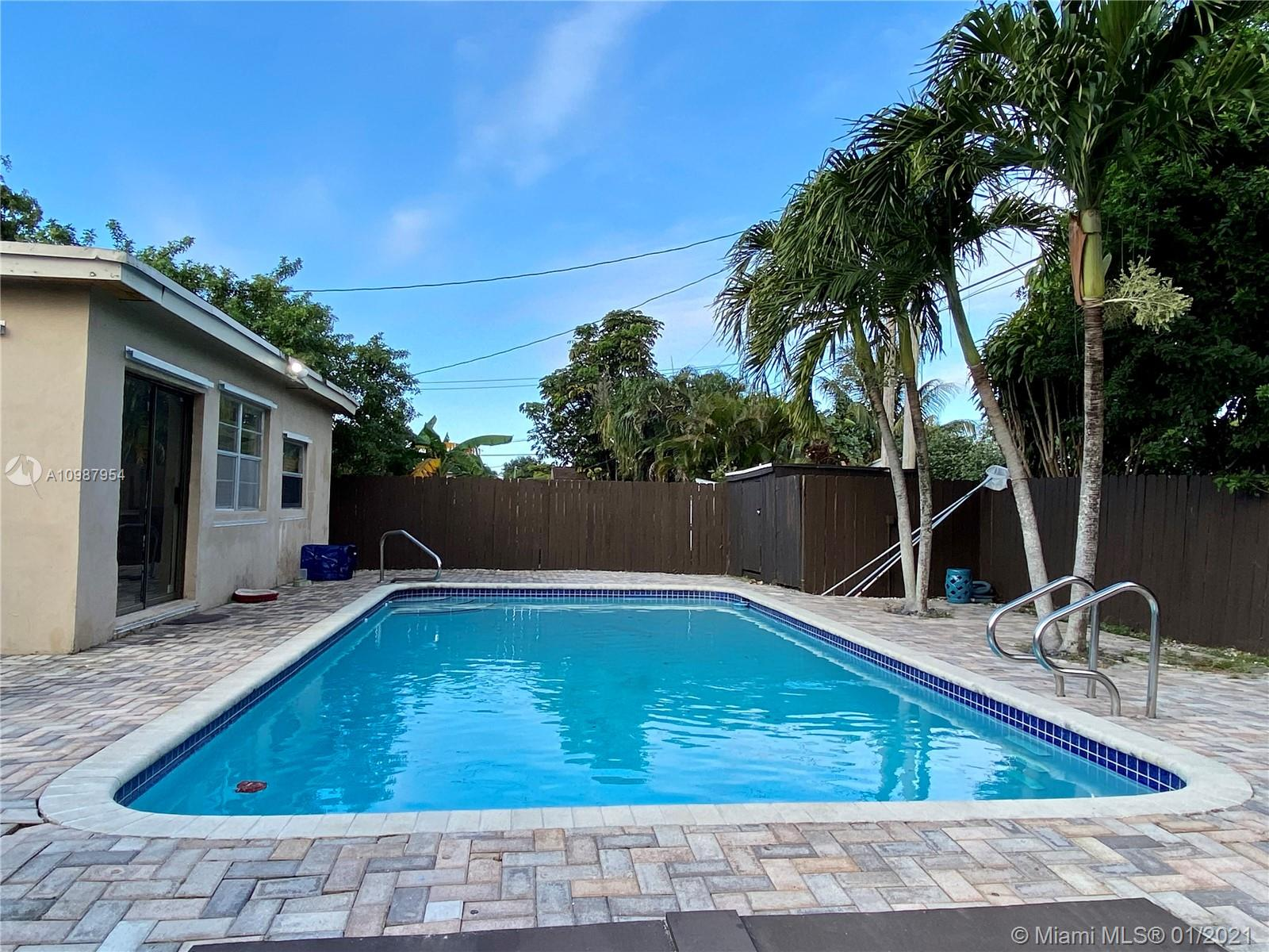 Beautiful pool home , fenced patio with nice pavers and palm trees, 2 sheds, one year old roof,circular driveway, and lot of space for additional parking, updated kitchen and bathrooms, tile  floor in  all areas. 3 bedrooms and 2 bathrooms,  laundry room, tank less water heater, hurricane shutters, Florida room. Quite, nice and safe neighborhood, and free of home owner association dues. Close to the South Broward Community College, schools and the Florida Turnpike.