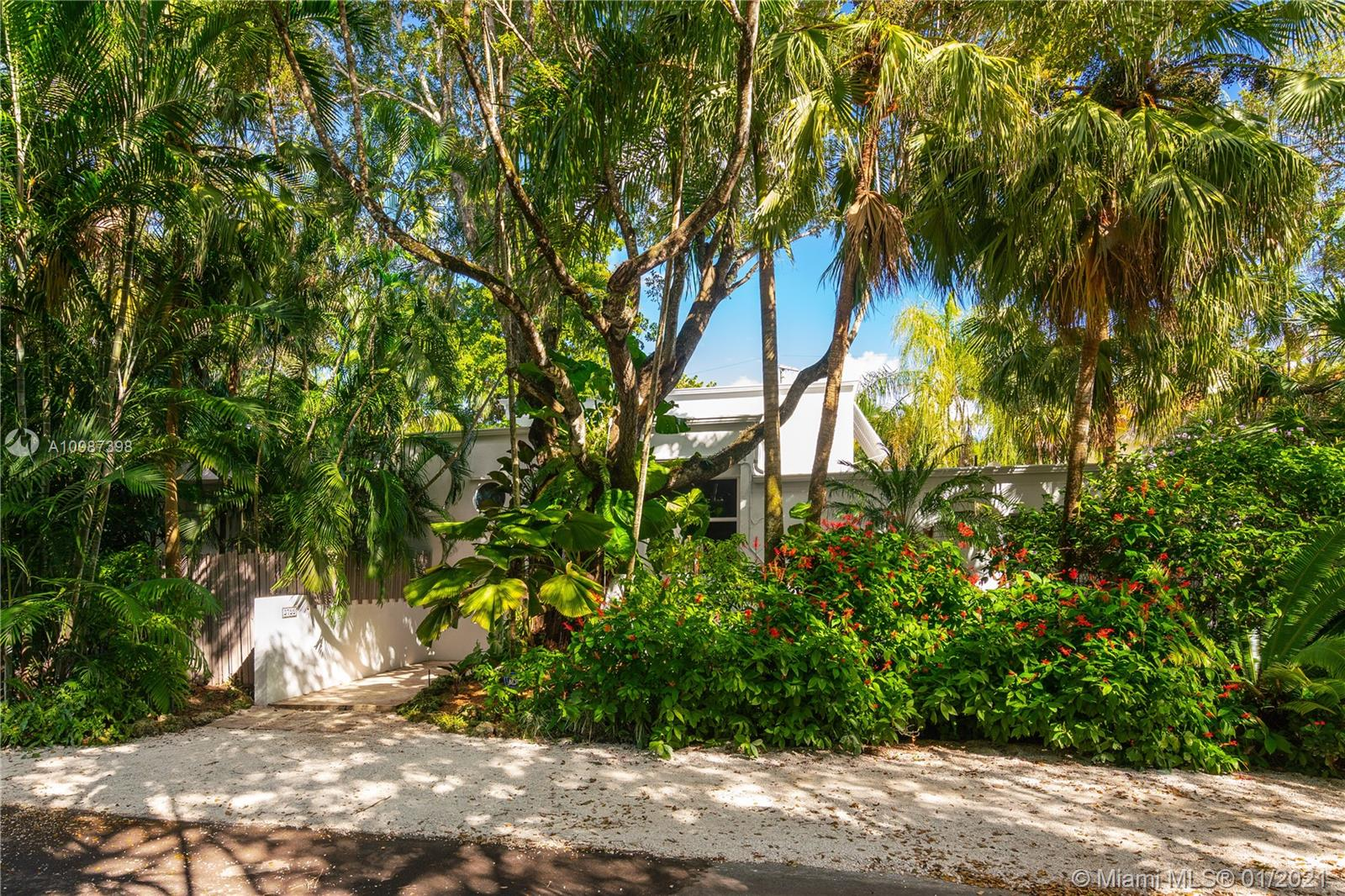 This beautiful contemporary is in a prime South Coconut Grove location. Dramatic and vibrant, this home is nestled within a lushly landscaped garden, offering daily reminders of the tropical paradise that defines the Grove. The living room overlooks the newly resurfaced (and very fun) swimming pool as well as a pavilion for alfresco dining. The master bedroom, with his and hers walk in closets and updated master bath, is a Zen retreat. A second-floor loft which can serve as a library, office, gym, or media room has a wet bar with a wine cooler. The efficient kitchen with its gas cooktop and Viking appliances overlooks a charming dining room which will be the setting for long, lingering dinners and great conversation. One car garage & covered carport. A Very Special Home.