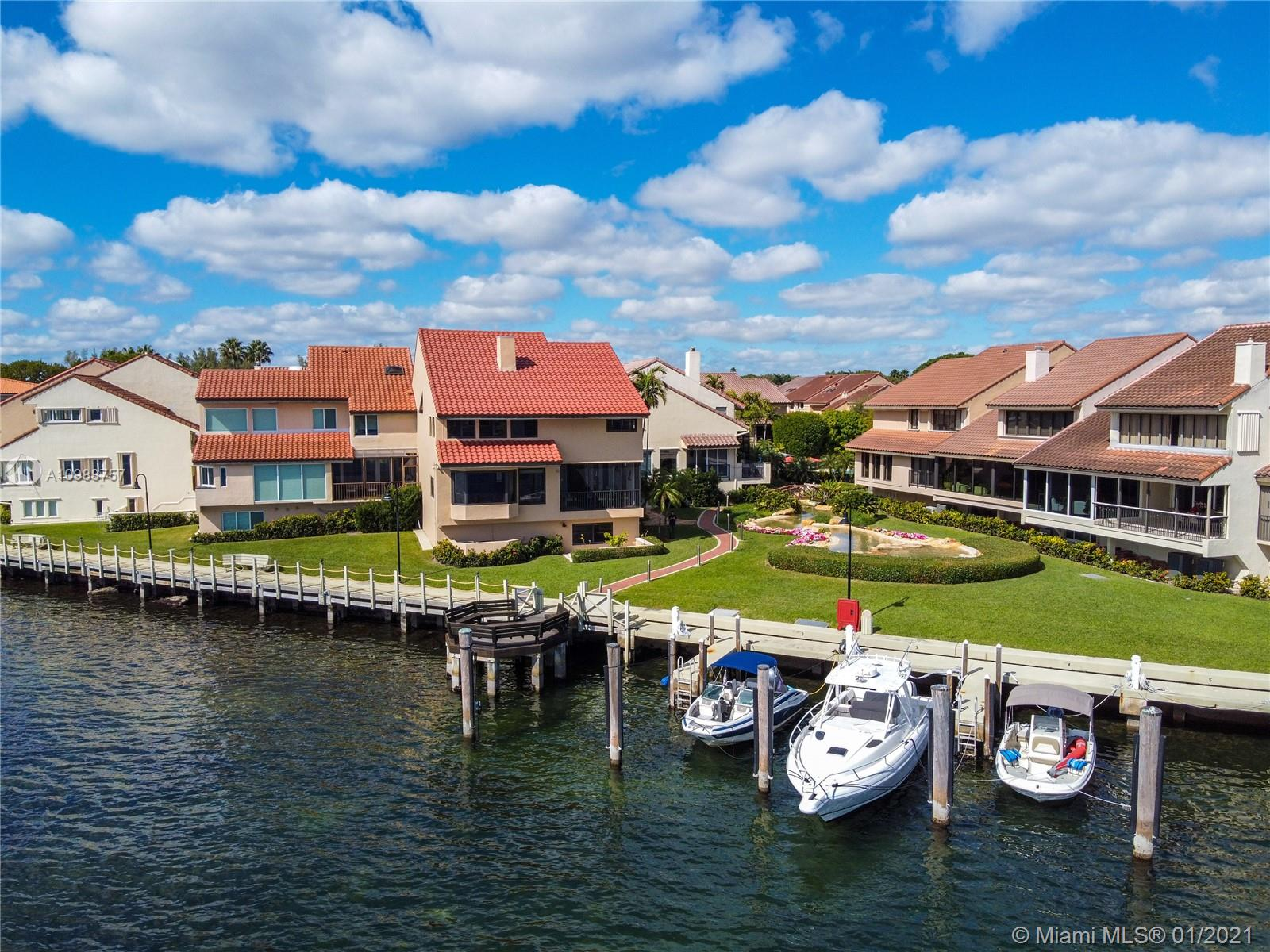 Get ready to be amazed by this beautiful waterfront townhome, with a dock, in the one-and-only gated community of L'Hermitage in Coconut Grove. Enjoy the expansive water views of Biscayne Bay and the Atlantic Ocean while sitting on your terrace or by gazing through the large bay windows inside the comfort of your own living room. This 4BR/4.5BA villa has been completely renovated inside and out, and includes full impact doors & windows, along with a 2018 roof. Wolf & Sub-Zero appliances in the kitchen. Coffered ceilings with custom shelves and cabinets in the living room. Bar w/ wine cooler & ice maker compliments the large living area with the Hemingway den. Elevator w/ modernized cab and equipment. 2 private outdoor lounge areas. Garage plus carport. Includes exclusive use of boat slip.