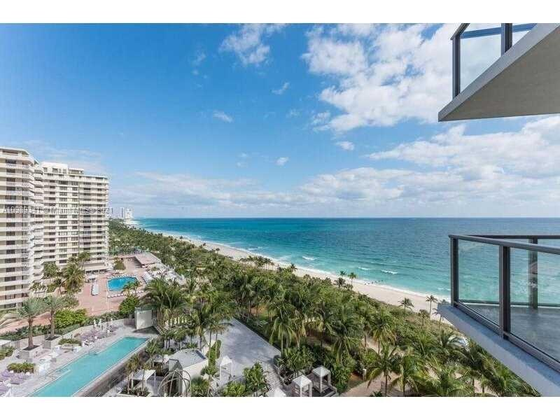 Direct Ocean, completely outfitted by ST Regis. 1 bedroom and FULLY ENCLOSED DEN Plus 2 bath. TWO direct ocean facing balconies. Fully enclosed glass door in den makes it a full 2nd bedroom. Fully furnished & outfitted:
