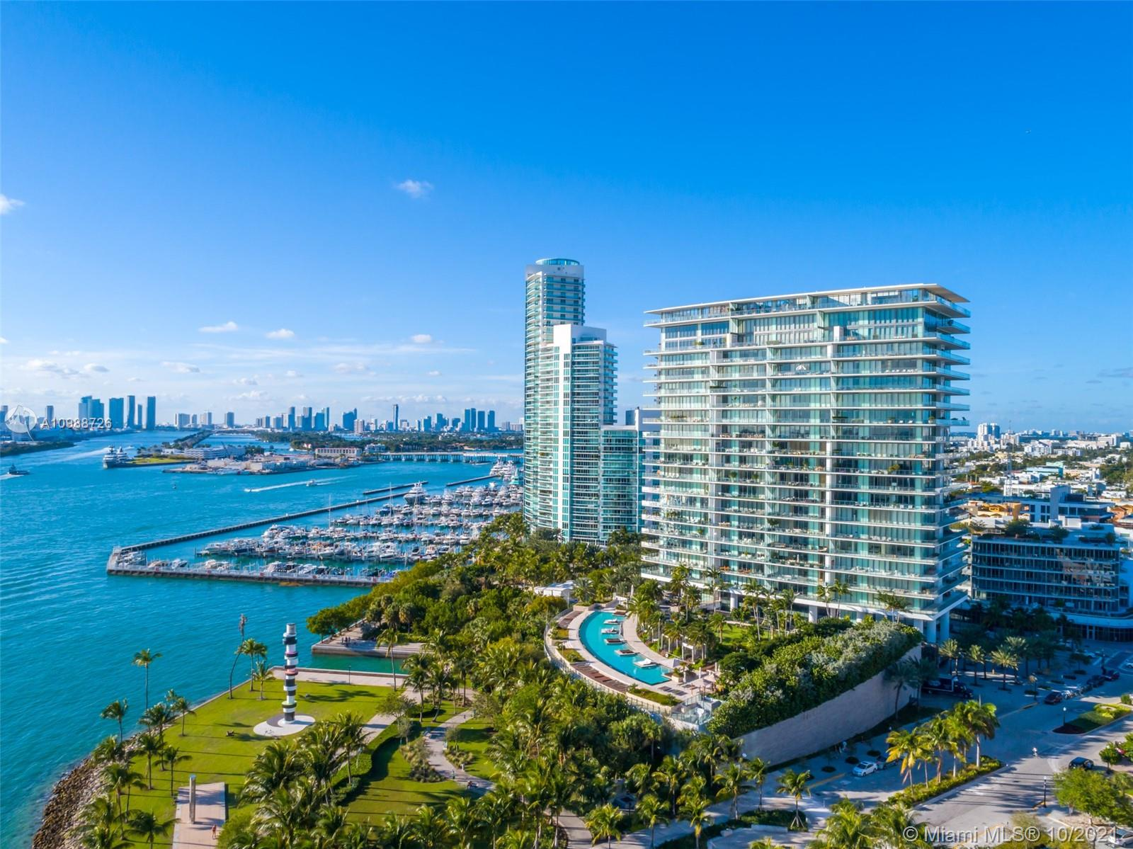 Enjoy stunning panoramic views from this high floor 01 at Apogee.  With 11 ft high ceilings, and an 11 ft deep wraparound terrace lined with floor to ceiling glass, this residence offers the ultimate condo lifestyle in Miami Beach.  Comprised of only 67 residences Apogee is exclusive and private making it the top choice for discerning clientele.  With 4,154 sf of interior and 2,446 of terrace, and a private air conditioned two car garage, 1401 offers a spacious floor plan fitting the needs of full-time residents relocating to Miami or looking for a vacation property. Located on prestigious South Pointe Drive in the most pedestrian friendly neighborhood in town adjacent to South Pointe park and surrounded by the area's best restaurants and entertaining and beach.