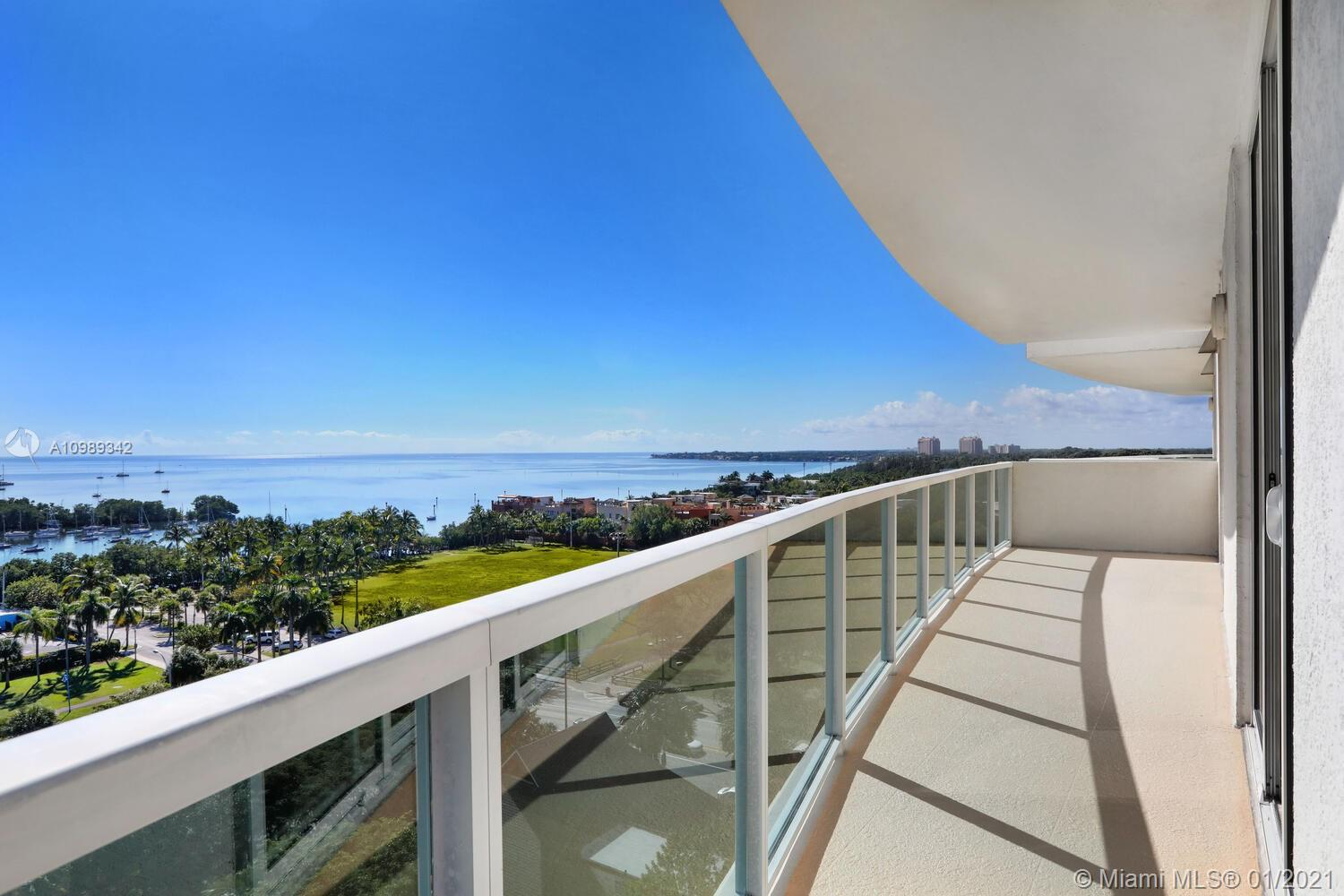 Enjoy spectacular views of Biscayne Bay from this light-filled residence in the heart of the Coconut Grove village. Just steps to galleries, boutiques, cafes & bayfront parks & marinas. 2BR/2.5BA corner unit with wood flooring, open kitchen & wrap-around balcony. Full-service, luxury building offers option to participate in hotel rental program for part-time residents (no rental restrictions ). 1st class amenities include pool & restaurant overlooking the bay, fitness center with sauna, squash courts, business center & 24 hr attended lobby w/ concierge. Secure garage parking ( 1 assigned space) as well as valet & street parking for guests. Minutes to downtown, MIA, Brickell, Coral Gables, Key Biscayne and the Beaches.