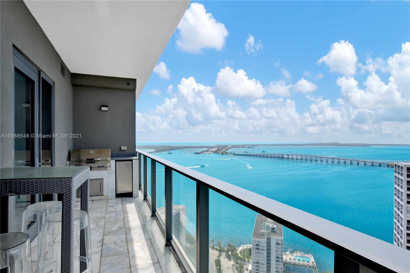 Manhattan meets Miami. 2 Units combined to one. Tastefully decorated with no expense spared. Watch the breathtaking sunrise over Miami Beach and the sunset over Brickell and Coral Gables. Views all the way to The Biltmore Hotel and the Marlin's stadium. Gaze at the city's lights at night.  Brand new in the heart of Brickell and the second largest unit in the building with over 3,300 sqft of living space. Luxury finishes throughout including 11 ft floor to ceiling impact windows, porcelain flooring, subzero/wolf appliances, Italian cabinetry, and quartz countertops. Captivating unobstructed water views from the outdoor BBQ terrace and magnificent city views throughout the rest of the unit. Complimentary pet walking included! A Beautiful Miami home!