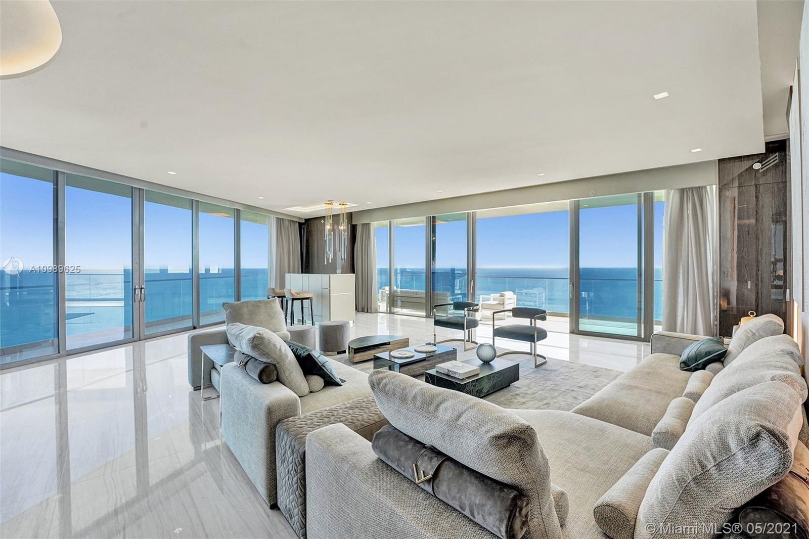 Welcome to Residences by Armani Casa. The most beautiful big corner unit and flow-through residence with unobstructed views to Ocean, City Views and Intracoastal. This residence features 4 bedroom /5.5 Bathrooms + service room masterfully distributed in 4083 sqft of living area, with wraparound terrace with floor to ceiling windows. Exquisitely finished with imported Italian Marble and decorated to detail, comes fully furnished with partial Fendi Furniture  with beautiful combination of textures and colors. Armani Casa Residences offers State-Of-The-Art Amenities: Restaurant, Bar, Pool, Business Center, Spa and Fitness Center,  Theater Room, Cigar and Wine Room, Children's play area, Security, Concierge + Valet Parking. This is a must see Unit, it will take your breath away. Easy to show.