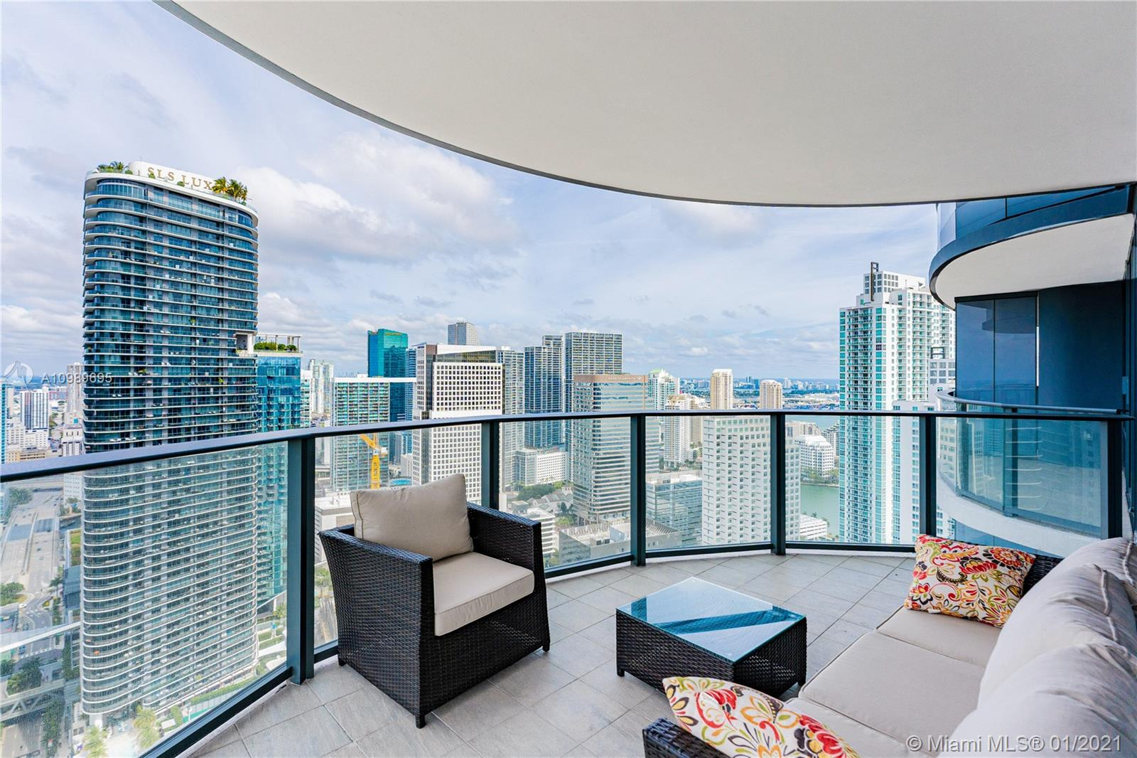 Awe-Inspiring Views w/Smooth, Smart & Sophisticated professional interior design.  This CORNER unit offers the finest, unparalleled, unobstructed N & W vistas. See sunrise over Miami Beach thru Sunsets.  It took 10mths to complete this showcase Designer unit with venetian plaster accent walls, open kitchen w/ Miele high-end appliances, Italian finishes, masterpieces from Ugo Colombo, upgraded doors, smart LED lighting system, remote control blinds, add'l DEN/OFFICE,
