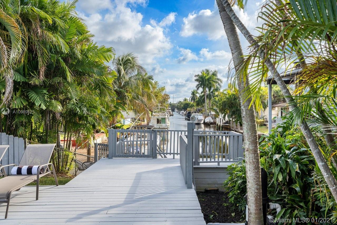 Live the Florida lifestyle in this ocean access waterfront 3 bed/2 bath pool home in Fort Lauderdale.  This updated home features Impact glass, a newer AC and pool pump, laundry room and pantry.  Expansive outdoor entertaining area featuring a pool, separate spa, covered bar area, storage, and a lighted 20 foot dock.  There is ample parking behind the front gates to store an RV or a trailered boat.  Located in an established neighborhood with no HOA and close to amenities including a community boat slip and parks just blocks away.