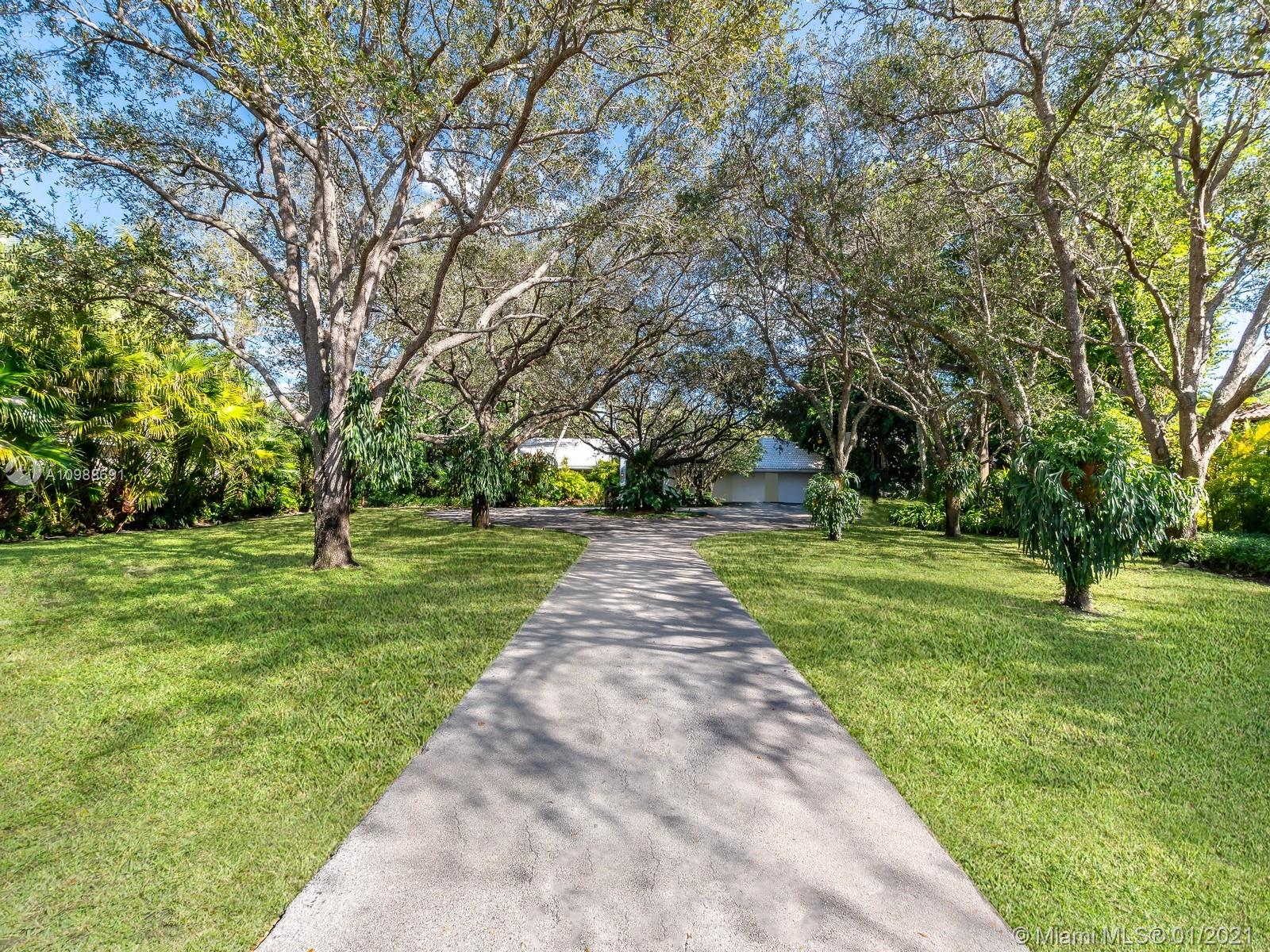 Lavish Gated ONE ACRE Estate on Highly Desired Ponce Davis. Strikingly beautiful 5 bed /6 bath on a gated 43,560 SF Lot with sprawling 6333 SF Liv Ideal family compound, with family friendly communal spaces yet elegant and tropical chic for entertaining. Formal living room with fireplace. Master suite with its own library / office and spa-like bathroom, covered terrace courtyard style pool area, with vast outdoor terraces with entertaining areas embracing South Florida living.  All 5 bedrooms have private en suite bathrooms.  Mature oak orchard entrance with circular driveway 2 car garage.  Walking distance to premiere schools in South Florida. Remodeled in 1999 and updated in 2018. Take Advantage of this amazing opportunity in Ponce Davis!