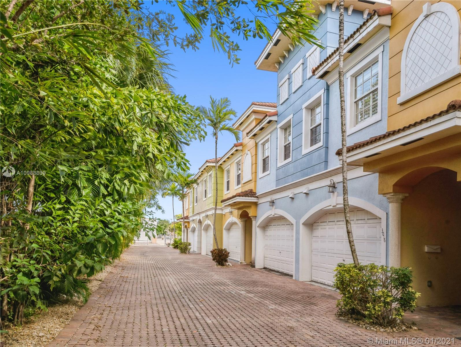 Great value in this Wilton Manors 3BR / 2.5 Bath townhome with impact windows and doors, 10 ft  ceilings and 2 car garage!  First floor includes modern open kitchen, half bath, large dining and living areas with French doors opening to lovely fenced garden/patio.  Large upstairs Master Suite includes two walk-in closets, a private balcony, and tray ceiling.  Master bath has been completely renovated with custom cabinetry, dual sinks, soaking tub, and oversized glass enclosed shower.  The 2nd and 3rd upstairs bedrooms share a guest bath.  Laundry is conveniently located on the 2nd floor of the residence.  Only 12 townhomes in the complex.  Low maintenance.