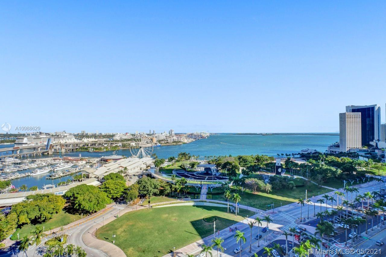 FANTASTIC UNOBSTRUCTED BAY & CITY VIEWS FROM EVERY WINDOW AND 2 BALCONIES, GREAT LAYOUT, 1474 SF OF LIVING AREA, VERY BRIGHT AND AMPLE, 2 BEDROOMS, 2-1/2 BATHROOMS, WITH BIG WHITE PORCELAIN FLOORS THROUGHOUT THE UNIT.  KITCHEN WITH STAINLESS STEEL APPLIANCES AND BLACK GRANITE COUNTERTOP. GORGEOUS AMENITIES INCLUDE 4 POOLS, GYM, SPA, CLUB ROOM, WITH POOL TABLE & KITCHEN, SUNDECK, BUSINESS ROOM, THEATER & MORE. LOCATION IS PERFECT, NEAR BAYSIDE MARKETPLACE, MUSEUMS, OPERA HOUSE, RESTAURANTS, WHOLE FOODS MARKET AND NOT FAR FROM BRICKELL AND MIDTOWN.