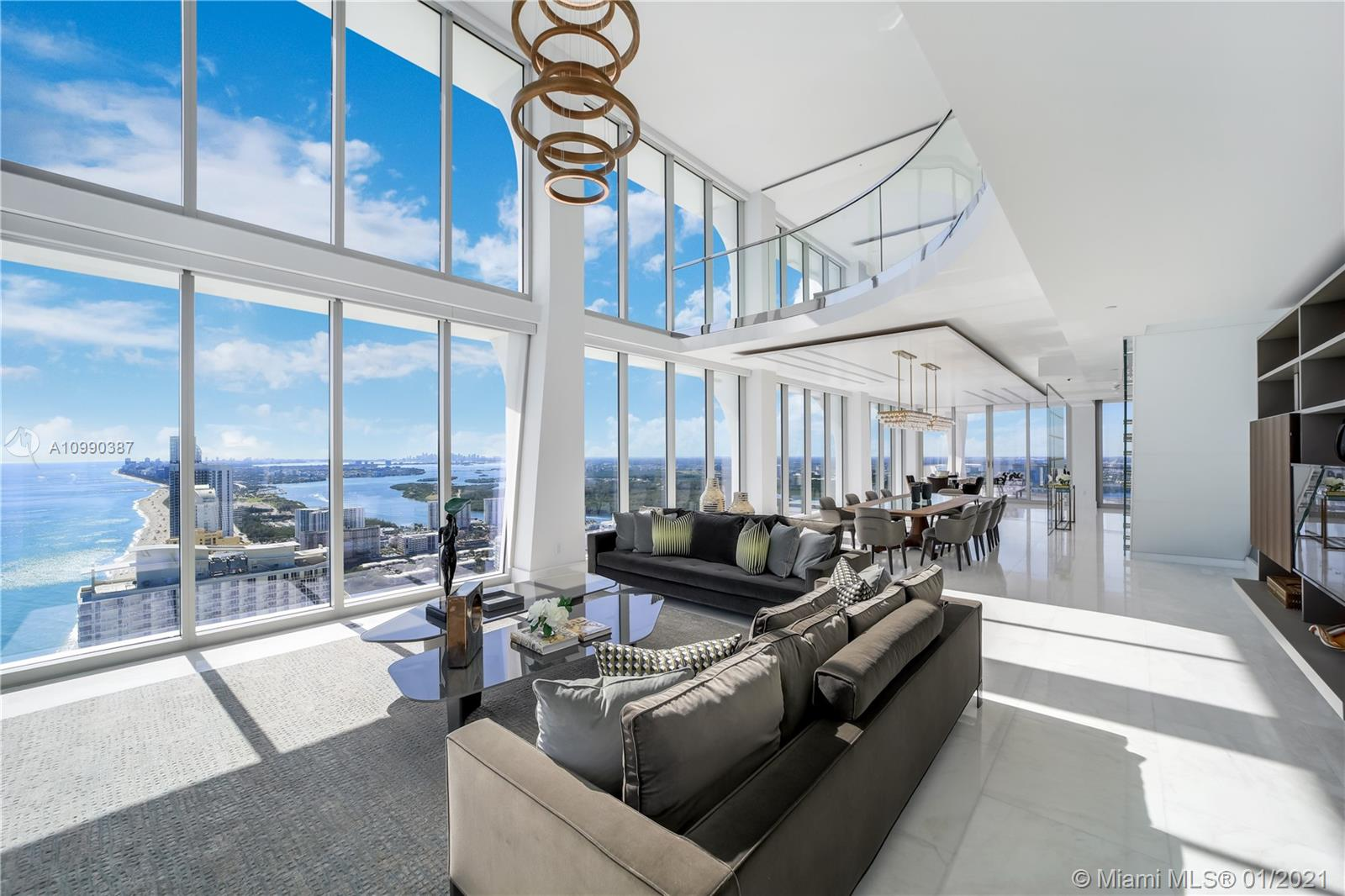 State-of-the-art living meets pristine oceanfront coastal views in this Jade Signature residence, part of the ultra-luxury condo tower created by Pritzker prize-winning Swiss architects, Herzog & De Meuron, and interior architecture by PYR led by Pierre-Yves Rochon. The premier 2-story SE corner Upper Sky Villa is a seamless indoor/outdoor living experience. Unparalleled 180-degree water views are witnessed from 6,735 SF of living space & 1,161 SF of private terraces. Soaring 20-foot ceilings, modern and tasteful opulence describes the villa's finishes & decor offering an elevated experience in entertaining. Superior amenities, lush gardens, direct beach access, make this magnificent Sunny Isles Beach property, in the heart of our American Riviera, a rare find. Welcome to Miami!
