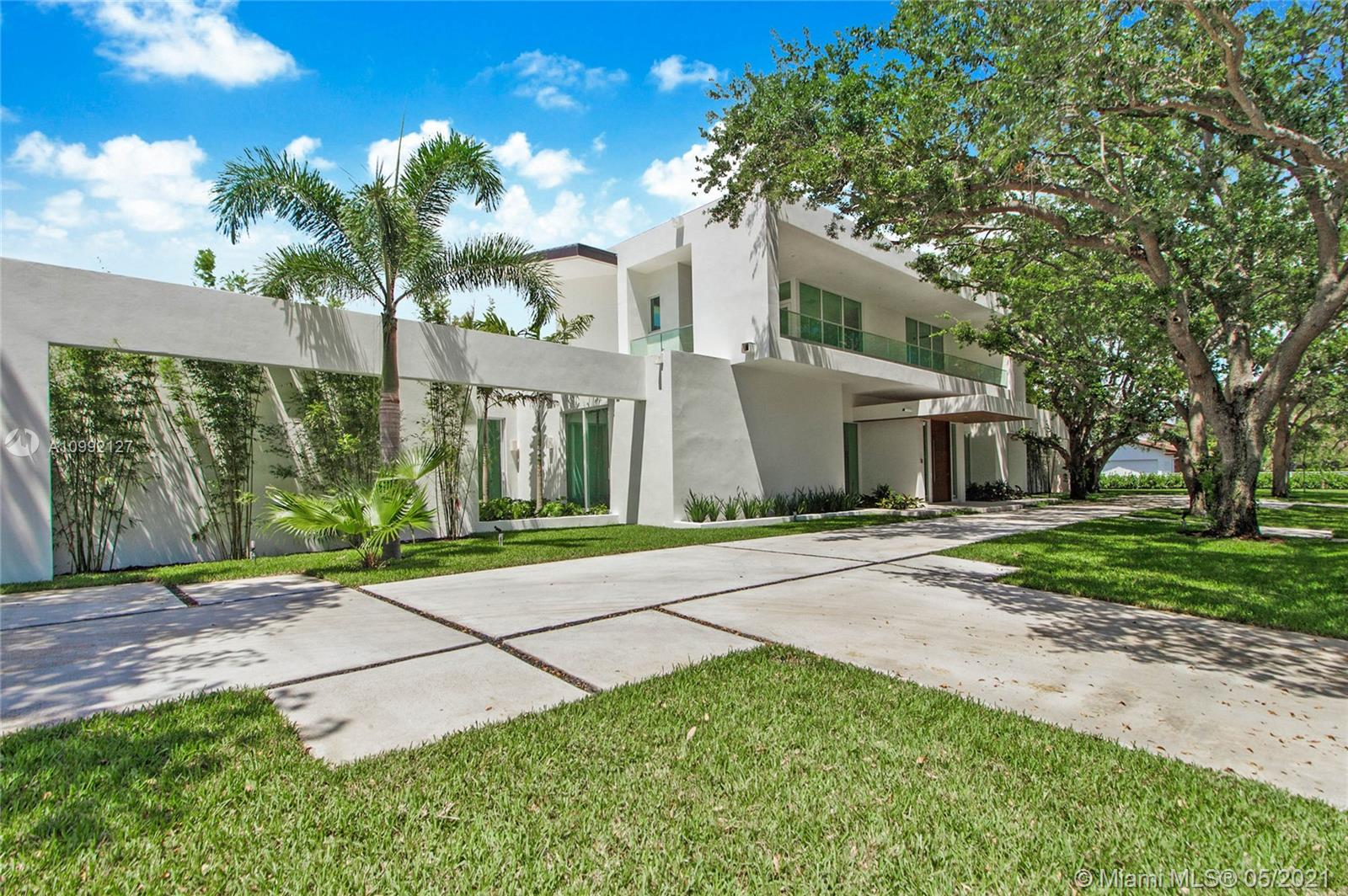 Incomparable luxury at the crossroads of Coral Gables and Pinecrest. This brand new custom estate features flawless contemporary design from renowned architect, Giorgio Balli. The open-concept, 9,043 total SF interior boasts 7 bedrooms, 6 bathrooms, 2 half bathrooms, soaring 14'-high ceilings and impact-resistant windows, wood and Imported Italian marble floors, and custom Italkraft kitchen and baths. The ground level features an owner's suite, 2 guest suites, 2,200-bottle wine cellar, the finest contemporary finishes, Elan Smarthome System & ample storage. The outdoor spaces mimic the sleek & sophisticated design of the interior and offer a 44' saltwater pool, 300+ SF covered poolside terrace & summer kitchen...all on nearly an acre of lush grounds. Experience the new standard of luxury!