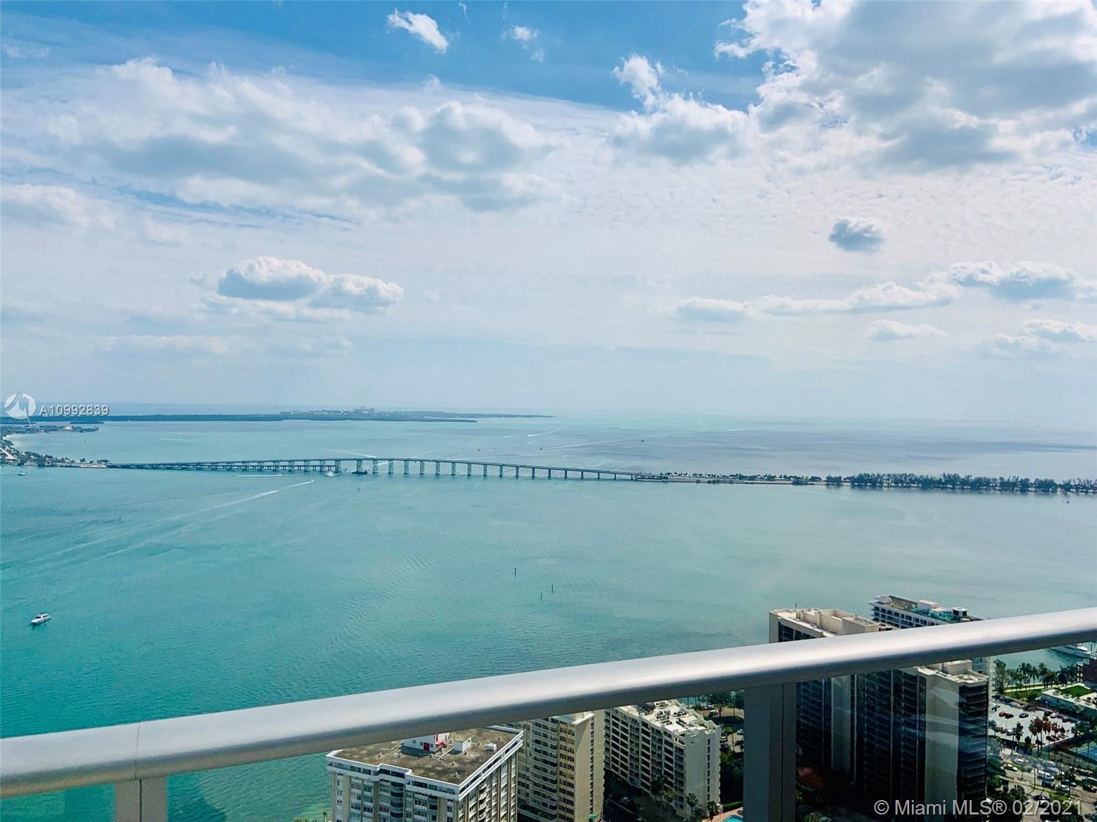 Beautiful corner unit with 2 bedroom/2 bathroom, white tile floors, fully equipped kitchen, walk -in closet, Floor to ceiling windows with shades and Balcony offering breathtaking views of Biscayne Bay. Amenities include 24hr welcome Desk and Concierge Center, 24hr Valet guest service, family areas, HD screening room with 10-ft screen theater-style seating, men and women steam rooms, barbecue area, mezzanine with heated whirlpool, expansive 46th floor sky deck with pool. Fully equipped technologically advanced fitness center and lounge.