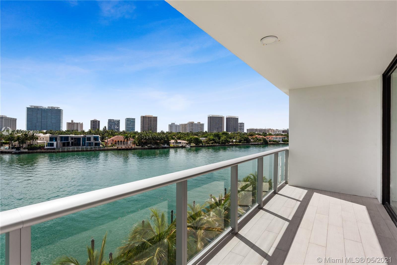 Immaculate 4 Bedroom +3 1/2 Bath + DEN with an incredible view to the bay and ocean for sale! Building designed by Corwil Architects and Steve G Interiors, located minutes away from the Bal Harbour shops and beaches. Walk or paddle board to the destination for fashion and luxury and A+ schools. 9ft High Ceiling, private elevator and flow through residences. Two assigned, covered self parking and a storage unit.