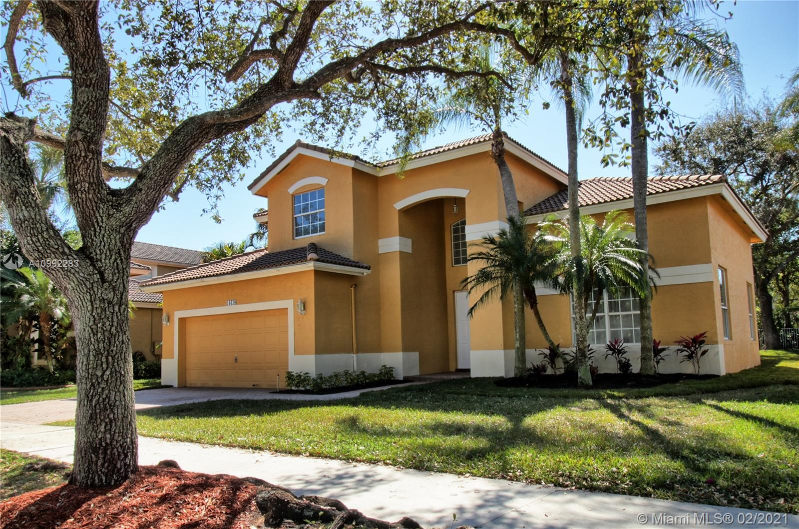 Spectacular and gorgeous home located in desirable Emerald Estates neighborhood. Completely remodeled, from top to bottom, with top of the line features. New Washer & Dryer, new Water Heater, new A/C, new Italian design kitchen with stainless steel appliances and wine cooler, new garage door opener, beautiful oversized quartz countertops, porcelain floors (porcelanato) throughout first floor and wood on second floor, new deluxe ceiling fans with light and remote control in every room, all bathrooms tastefully renovated with Italian tiles, high quality vanities and glass shower doors. Huge master bedroom downstairs with plenty of closet space Full service community includes lawn maintenance, sprinklers, basic cable, alarm monitoring as well as a community pool and gym. Weston's A+ schools.