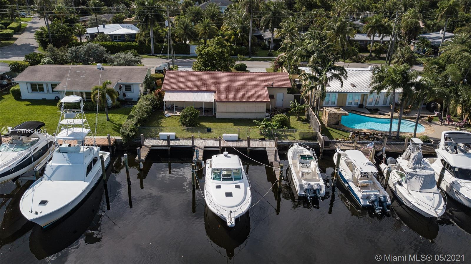 This 3 Bedroom, 2 Bath Home could be the Home of your Dreams, located in the highly desirable Lauderdale Harbor neighborhood, bordering Rio Vista! Your new Home offers 70' of waterfront on a WIDE river/canal with NO FIXED BRIDGES, including 3 docks! With its close proximity to the Port, Airport, Fine Dining, Brand New Platinum Whole Food and so much more, how could live or dock anywhere else? This Home is an Oldie but Goldie! Just bring your decorator, or if you choose, bring your contractor and build a Brand New Dream Home. Your choice! So what are you waiting for? Call today to see this diamond in the rough. This won't last long! You can be sure of that!