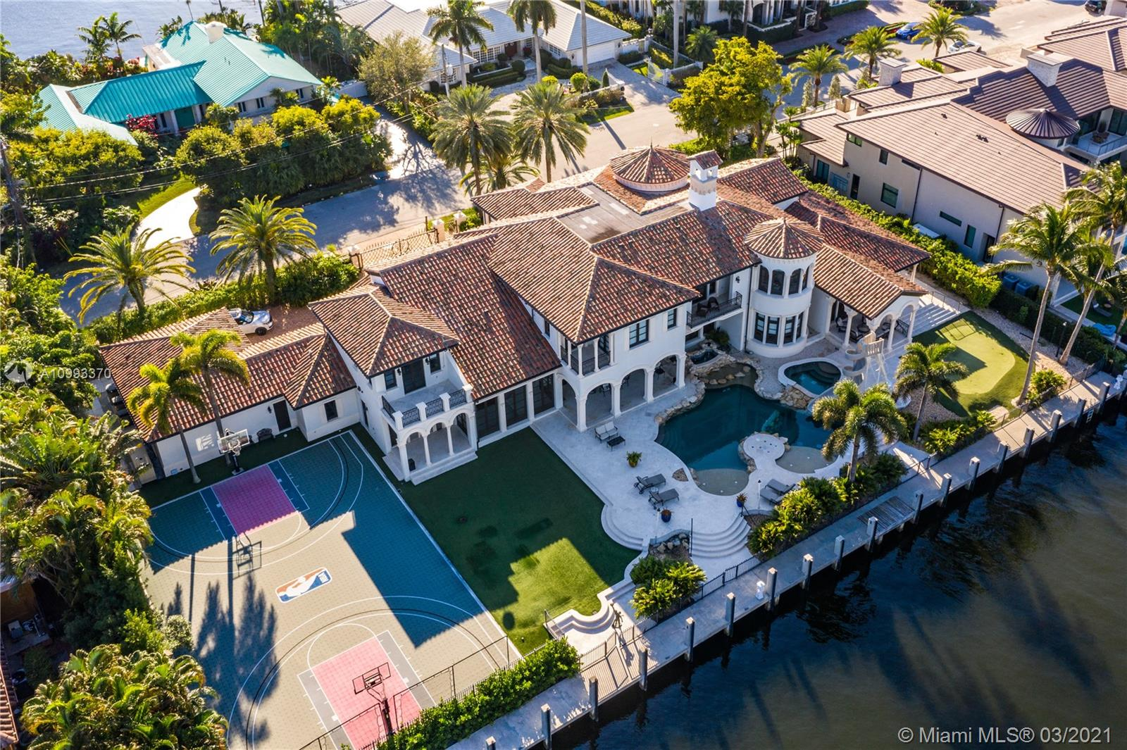 Located in Harbor Beach, one of the most exclusive gated communities in Ft Lauderdale, is the spectacular Italian inspired, resort-style estate designed by renowned Randall Stofft Architects. Meditteranean Villa spans almost 13,500 sqft on a double lot with 215' of frontage along the Intracoastal Waterway. A boater's paradise: deep water frontage on a 135' wide canal accommodates mega yachts up to 190'. The 6 bedroom estate has 7 full and 2 partial bathrooms, elevator. Perfect for entertaining with resort-style amenities: chilled wine room, theater, game room, gym, hot tub, swimming pool with a slide, fountains and a commercial-grade summer kitchen. The outdoor amenities also include a full-size NBA basketball court. Optional Surf Club membership and private marina available.