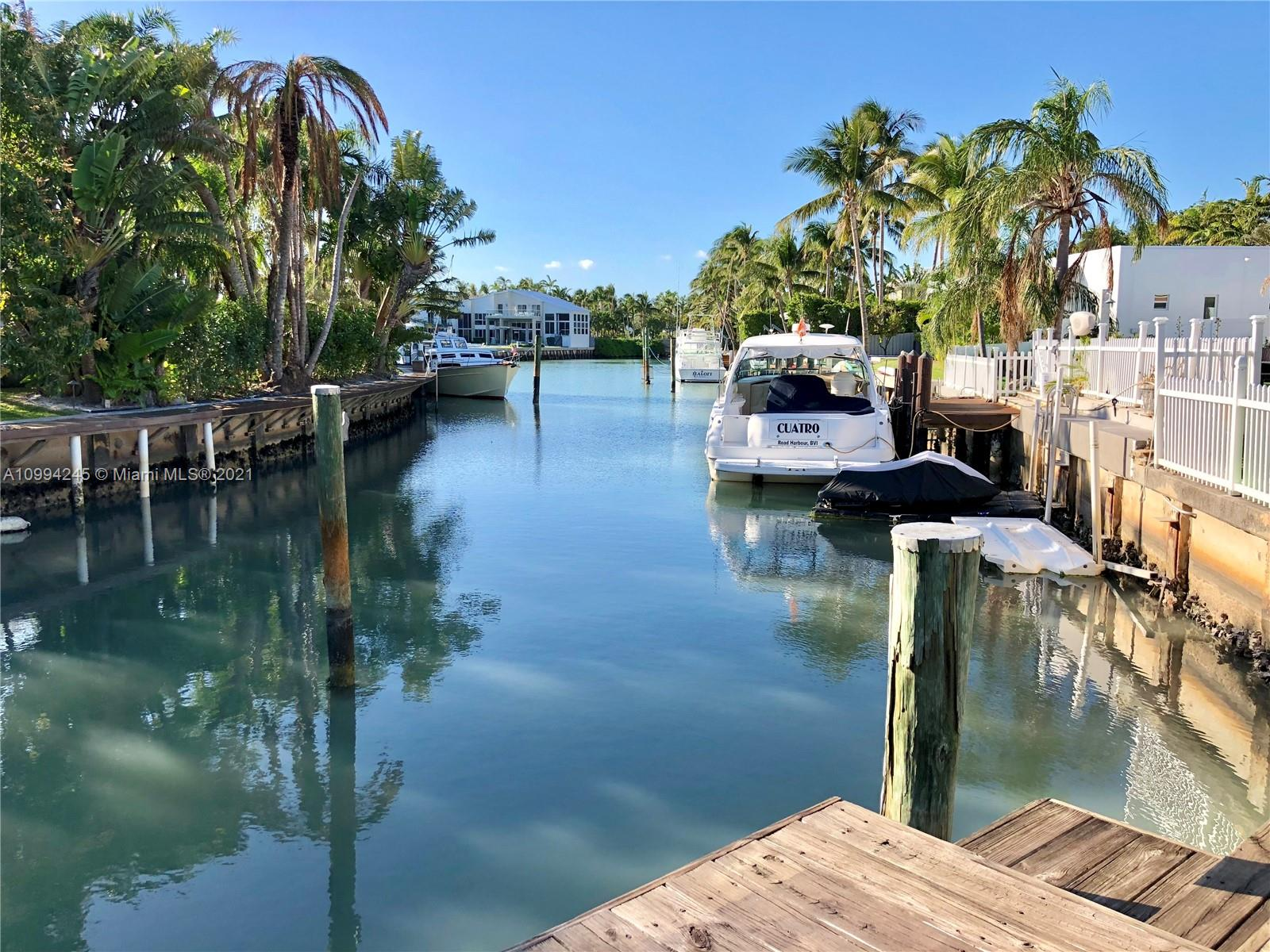 This home is located in a uniquely private corner lot at Island Drive and Cape Florida with 19,042 SF as per survey and over 25,000 SF of enjoyment, with a water frontage of 77 feet to accommodate comfortably a large boat.  Boaters paradise with absolute privacy. This home features marble floors throughout, remodeled kitchen and plenty of space with over 5100 SF under A/C, 5 Beds, 5 Baths.  See SURVEY attached for measurements (Second Survey available as well).