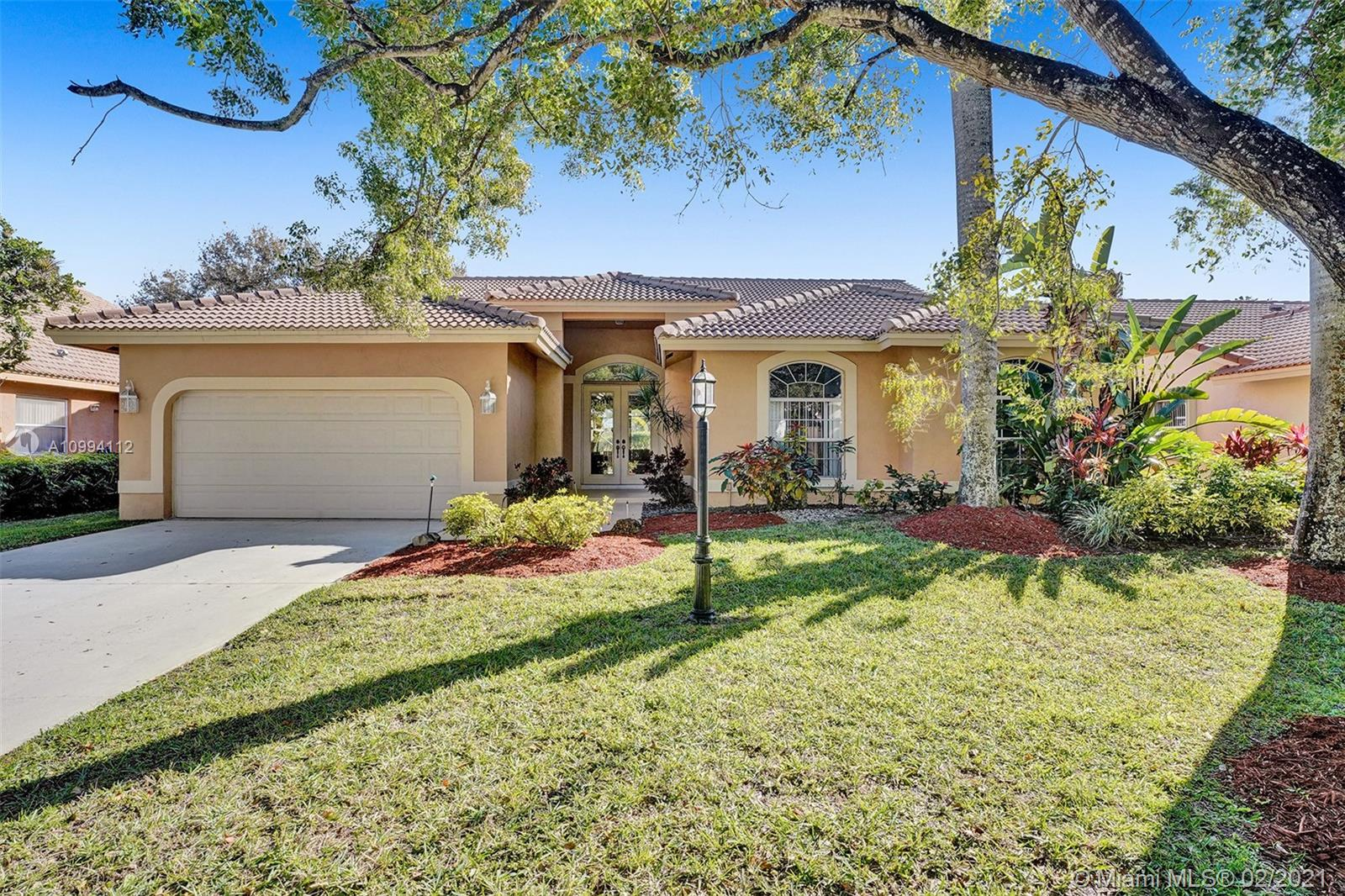 WOW! GREAT BUY ON THIS ONE OWNER HOME WITH PRIDE OF OWNERSHIP ON A WATERFRONT LOT IN 24-HOUR GUARD GATED HIDDEN HAMMOCKS ESTATES! QUIET TREE LINED STREET! NEW ROOF 2018! PLEASE SEE FACT SHEET!