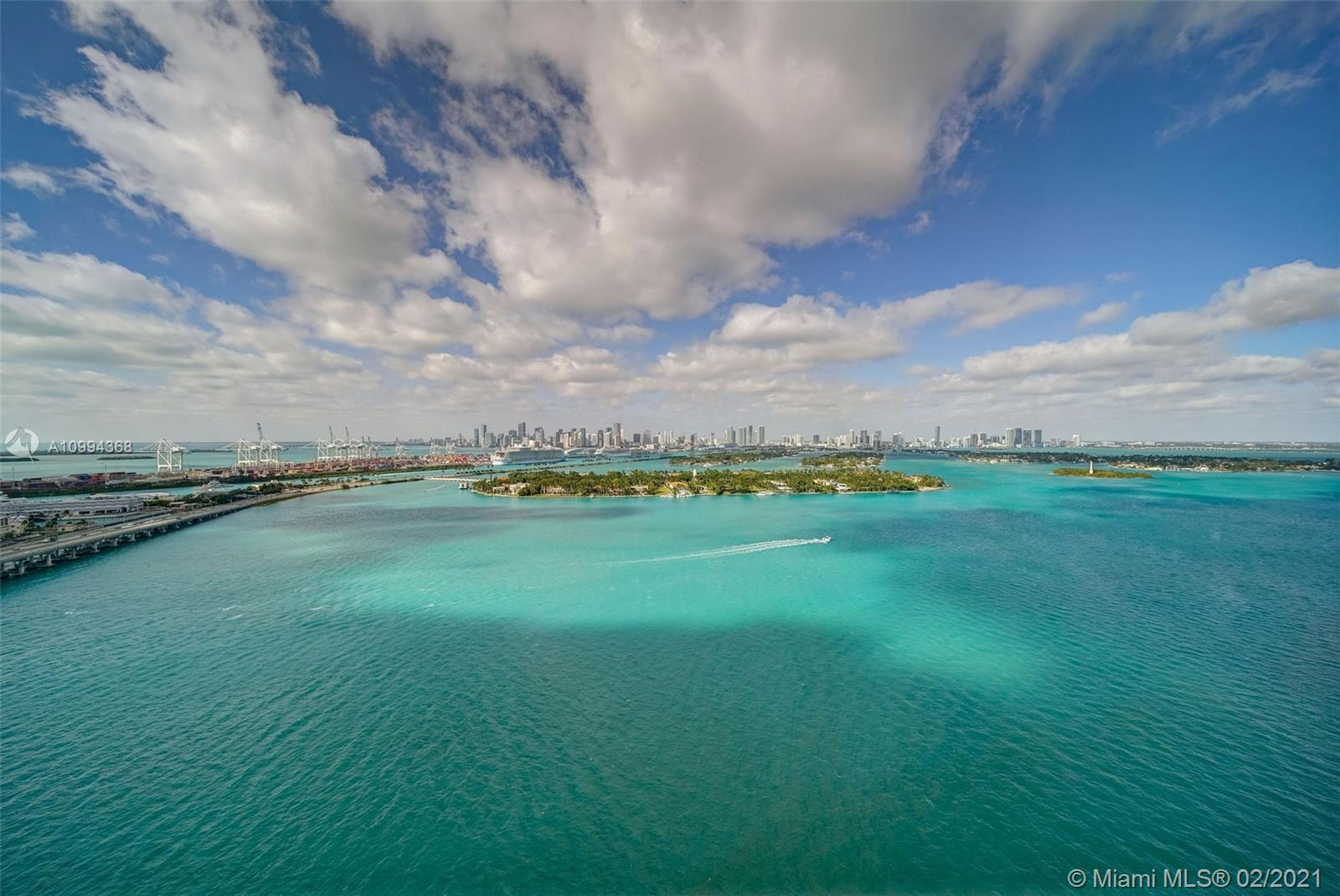 Spectacular and unobstructed views of Biscayne Bay and the Miami skyline. This stunning 3 Bedroom 2 Bath 1,372SqFt (see attached floor plan)  residence has been nicely renovated, highlighted by a new kitchen with quartz counter top and stainless steel appliances.  Perfect for entertaining with a counter height bar opening to a bright living space with awesome views.   This unit also features updated art inspired bathrooms, and in unit washer/dryer plus 2 parking spaces in the garage. The Floridian is a full amenity bay front building on Miami Beach.  Amenities includes 2 bay front pools, jacuzzi, tennis, poolside food/beverage, concierge, salon, gym & onsite gourmet market . The West Avenue neighborhood offers dining and shopping at your doorstep.   Convenient access to the causeway.