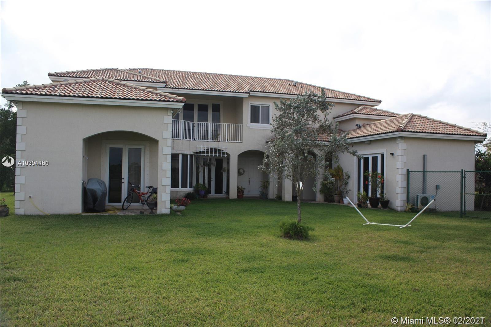 Beautiful 2 story home on large corner lot in the desirable gated community of Palm Isle Estates at Keys Gate!  This 5 bedroom 6 bath home features a separate in-laws quarters with full bedroom and bath, huge eat-in kitchen with granite counters, tiled first floor and carpet upstairs.  This beauty is on an oversized canal lot with a fenced in backyard.   Also has a courtyard area perfect for entertaining. Rent includes: 24 hour roving security,  AT&T cable and internet, alarm monitoring, tennis courts and more. Owner requires first and double security deposit, full credit reports and proof of employment, and association application fee for background checks.