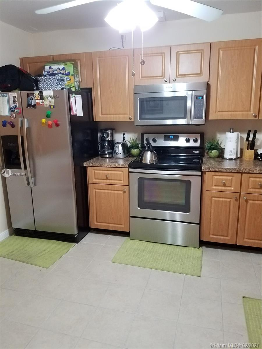 Don't miss out on this Spacious 2 bedroom 2 bath unit! HUGE 2 bedroom/2 bath 1350 sqft. in Hamptons West on 2nd floor w/beautiful lake views! Gated/fenced community. Property is being sold AS-IS without ANY repairs or warranties. newer appliances. Maintenance  includes: water, cable, internet. Min. 650 credit score required & $45,000 annual income. Assoc. requires a mandatory security deposit in amount of $3, 000 payable to Dorado at Hamptons at time of application. Refundable after 2-years of monthly maintenance payments paid on time. Seller is a FL licensed Real Estate Associate.