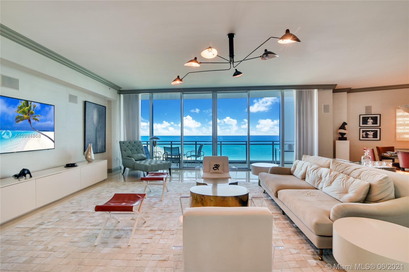 Price adjustment ! PANORAMIC DIRECT OCEAN, INTRACOASTAL & MIAMI SKYLINE VIEWS!  3 BEDROOMS /3.5 BATHS UNIT! THE MOST PRESTIGIUSE ONE BAL HARBOUR /RITZ CARLTON RESIDENCES WITH A PRIVATE FOYER ENTRY. 3 TERRACES WITH SUNRISE & SUNSETS VIEWS ,OPEN FLOOR PLAN FOR THE ENTERTAINMENT ,10 FEET CEILING ,MASTER SUITE W/ SITTING AREA,  WALKING HIS&HERS CLOSETS . GOURMET KITCHEN W/GAS STOVE ,WOLF APPLIANCES ,MIELE BUILT IN COFFEE MACHINE LAUNDRY ROOM,ASSIGNED PARKING,STORAGE ,5 STAR BUILDING AMENITIES FULL BEACH & POOL SERVICES GYM ,STEAM ROOM THEATER SOCIAL ROOM RESIDENTIAL CONCIERGE SERVICES,24 HOURS SECURITY VALET. ACCESS TO THE WORLD-CLASS RITZ CARLTON RESORT AMENITIES, FINE DINING RESTAURANT & SPA.