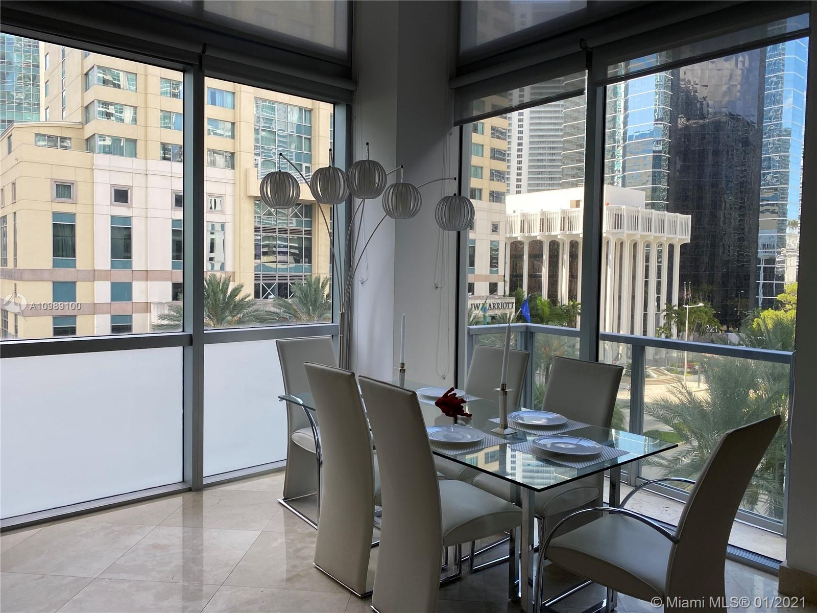 Beautiful two story loft, 18' Foot ceiling, marble throughout the apartment, city views, in the heart of Brickell. Amenities to enjoy include: pool with sundeck, state of the art fitness center, virtual golf room, wine & cigar lounge, family room, spa treatment rooms, yoga/aerobic room, game room with billiard table, lounge and party room with catering kitchen. THIS UNIT COMES WITH TWO ASSIGNED PARKING SPACES ON THE 4th FLOOR, YOU CAN WALK TO YOUR UNIT FROM YOUR PARKING SPACES!