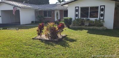 Located in the beautiful Hillbrook section of Wilton Manors West. This 1900 Square Feet+ home offers a heated pool 3 BR 2 BA is move in ready. Modern kitchen with granite and SS appliances. The living room, kitchen, Family room and Master bedroom all face the huge screened in patio and pool. Its the perfect place to entertain family and friends. The home has a laundry room with full washer and dryer and a storage room in the carport. This home sits on a large corner lot completely fenced. It is one of the most desirable neighborhoods in the area. There is a security system with cameras for additional security and a whole house water filtration system. Large 10,000 SF lot is perfect for those who love to garden or with fur babies to run. 2 gates you can park a boat or rv on the side.