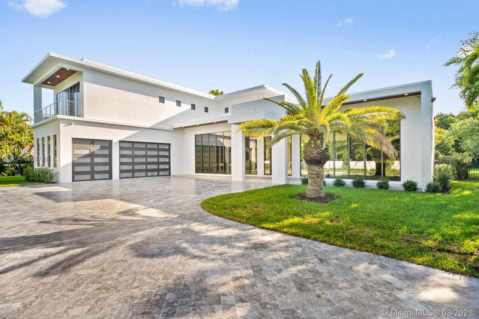 PRICE ADJUSTMENT MODERN GEM. Welcome to this stunning NEW CONSTRUCTION home in the sought after North Pinecrest neighborhood. Enjoy living and entertaining in this Exquisite Contemporary two story home with 5 generous suites, 5 1/2 bathroom's on a quiet cul-de-sac street. Highlights include an open concept gourmet kitchen with natural gas, custom cabinetry with top of the line appliances, oversized entertaining areas, soaring ceilings allowing for abundance of natural light to flow throughout, porcelain floors, large covered terrace, 3 car garage and large driveway for ample parking, elevator, impact windows and concrete roof. Enjoy the  pool with family and friends. Guest house with full kitchen can be added. Close to the best schools. Generator  ready. This home will not disappoint.