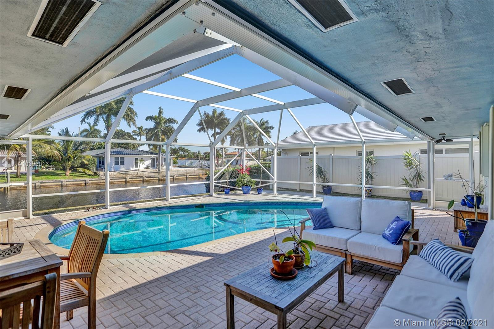 Captivating & spacious waterfront, pool home in highly desired Coral Ridge Isles. Ocean access in minutes, 4 fixed bridges. Boasting 75ft of waterfront this impeccable cul' de sac home has it all. Bright, spacious & open living concept floor plan, 2 large bedrooms, 2 baths & bonus (office/den space), inviting crystal clear pool & waterfront views from almost every room in the house & 1 car attached garage. All Miami Dade rated impact windows & doors, accordion shutters for additional protection, environmentally conscious EcoSmarte Ozone pool system (C02 +UV Sterilizer). Tech upgrade to whole house surge suppressor system, ultra low loss coax + CAT6 in bedrooms/living room, 16 channel security system w/ DVR, 14 night vision cameras with infrared LED's. 40 Panel solar grid system (optional)